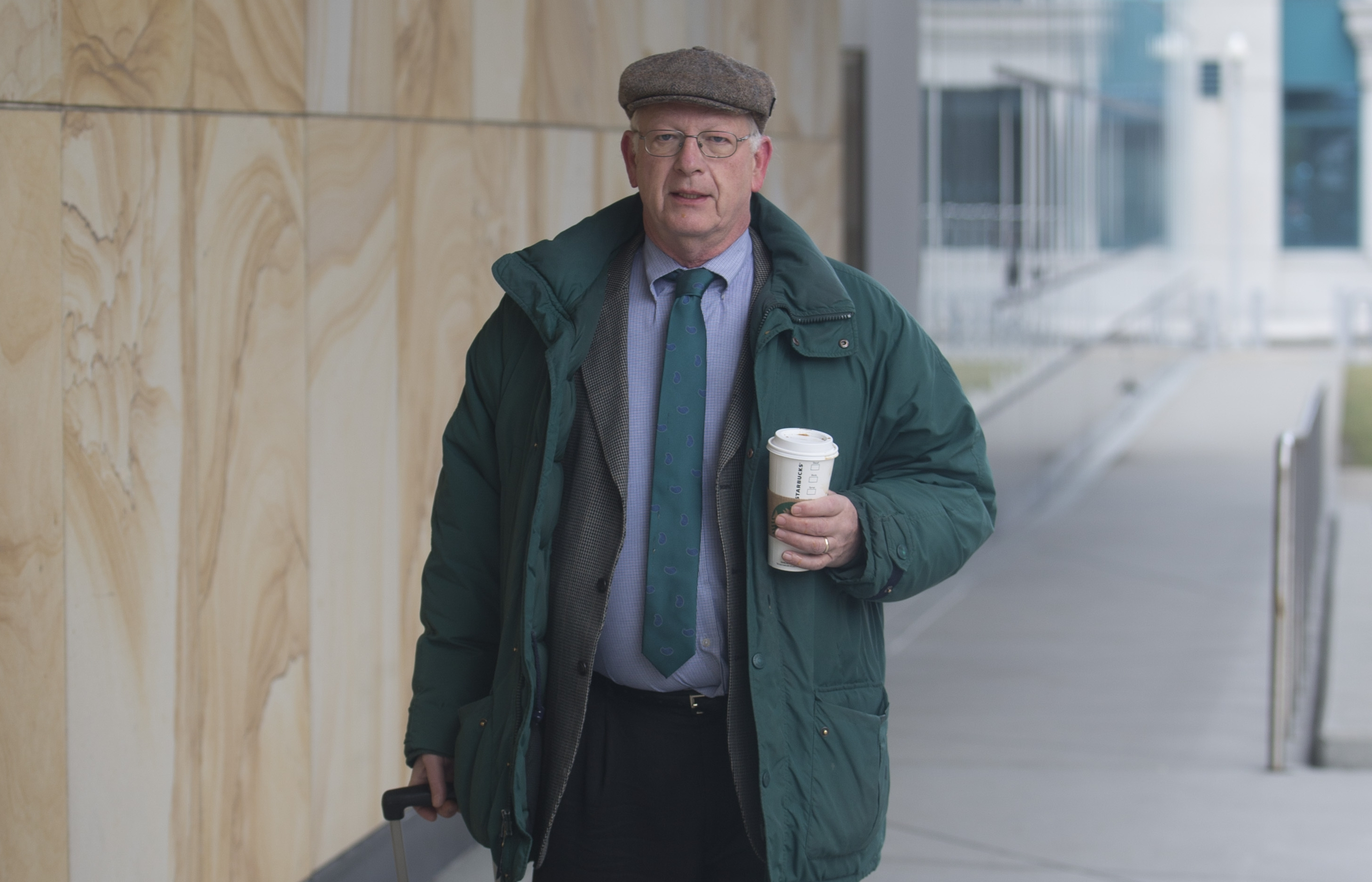 Mike MacQueen, one of the country's foremost war crimes investigators, arrives at Robert H. Jackson United States Courthouse on  Friday,  Jan. 27, 2017. (John Hickey/Buffalo News)
