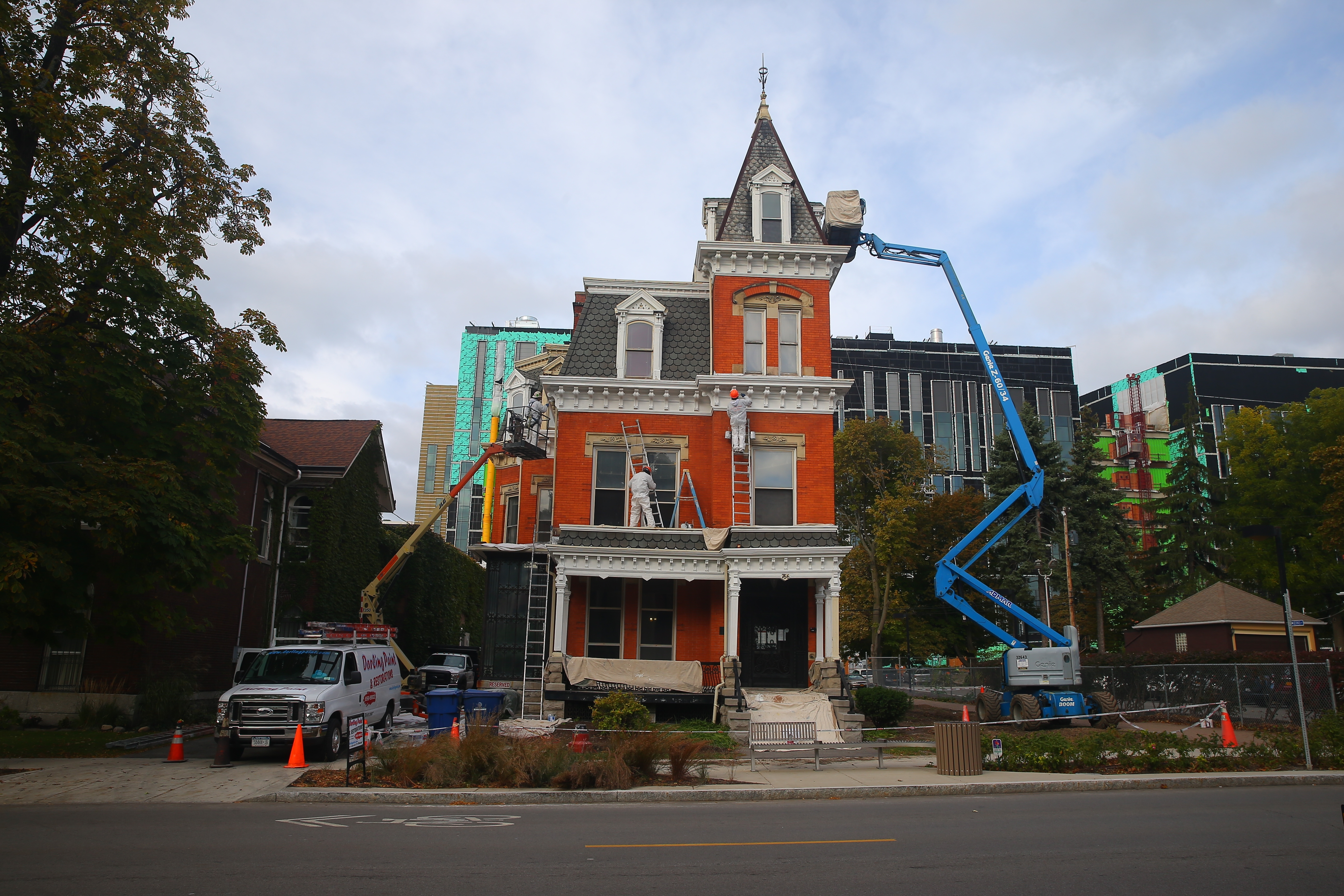 Workers paint trim on 766 Ellicott Street, shown here in October. (John Hickey/Buffalo News file photo)