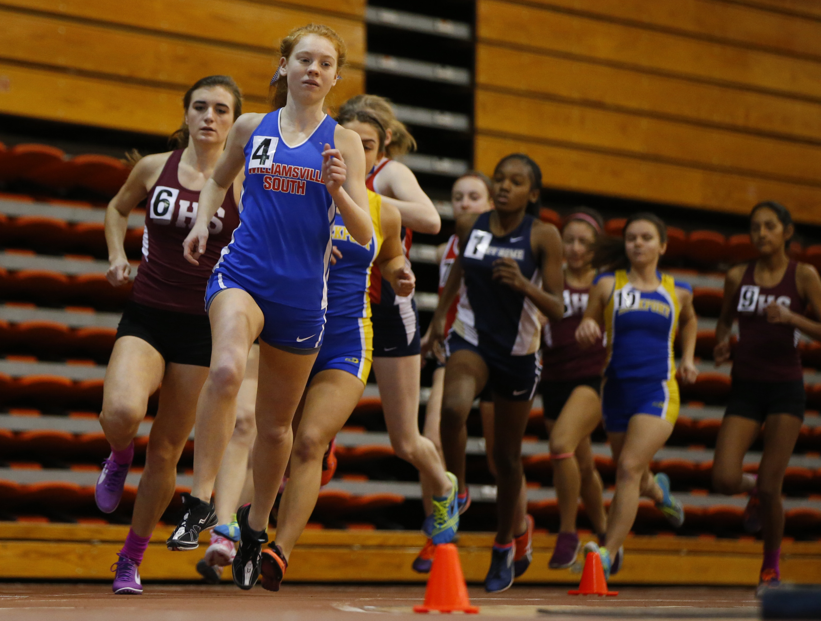 Girls compete in the 1000-meter run during a meet at Buffalo State on Jan. 7. (Harry Scull Jr./Buffalo News)