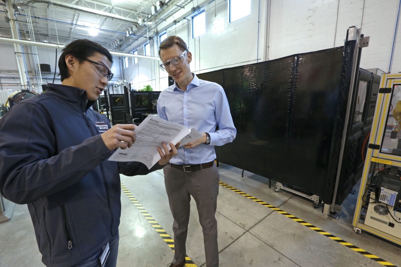 Chris Lee, left, an engineer on the advanced automation team, discusses a project with Buffalo Manufacturing Works CEO Michael Ulbrich. (Robert Kirkham/Buffalo News)