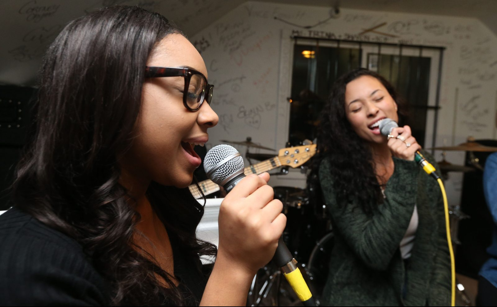 Mia Riot, left, and Maya By Name (Satterwhite) sing their hearts out during rehearsal. (Sharon Cantillon/Buffalo News)
