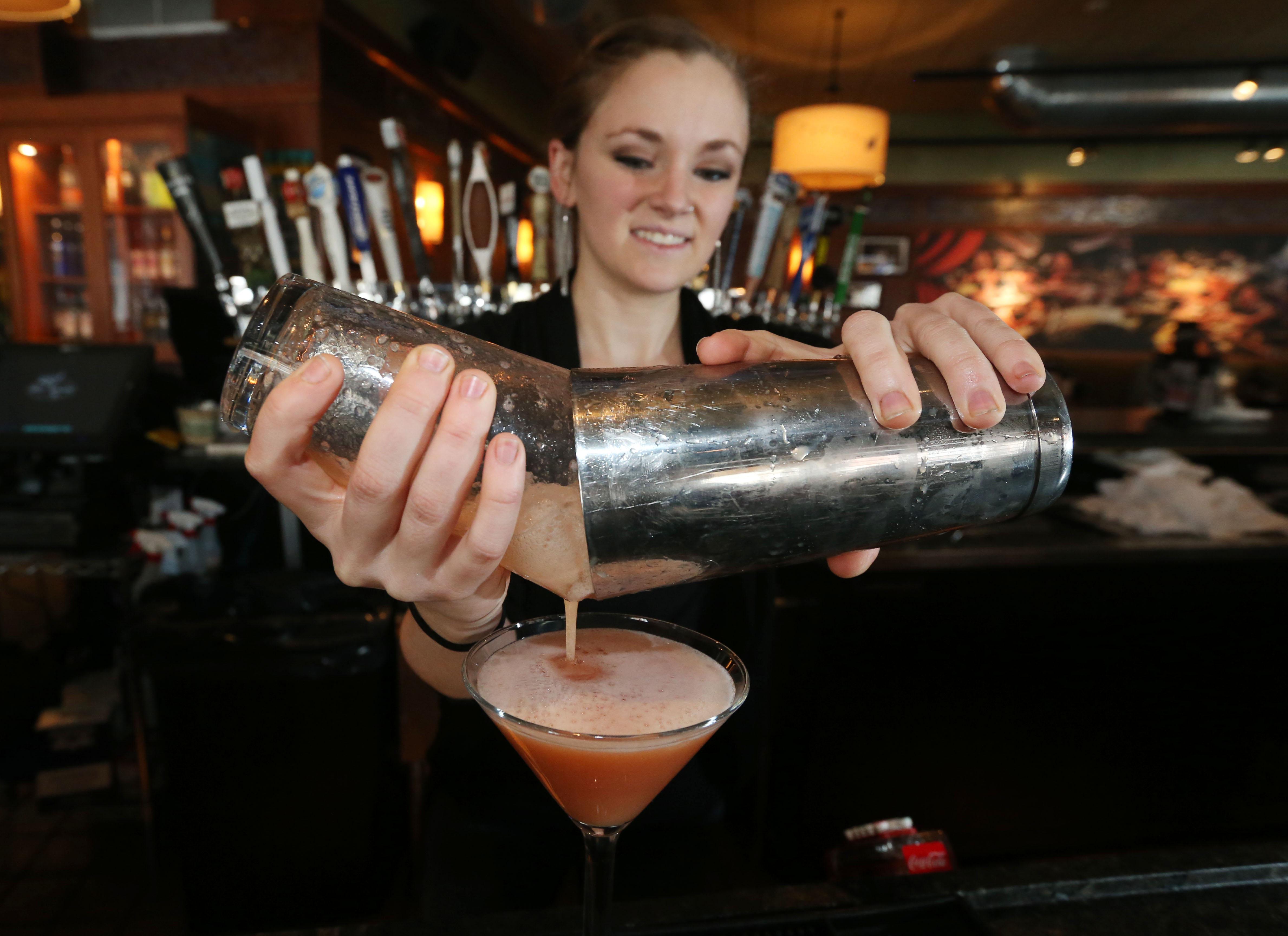 Bartender Jenny Kane, makes a cocktail at Bar Louie at Walden Galleria.  (Sharon Cantillon/Buffalo News)