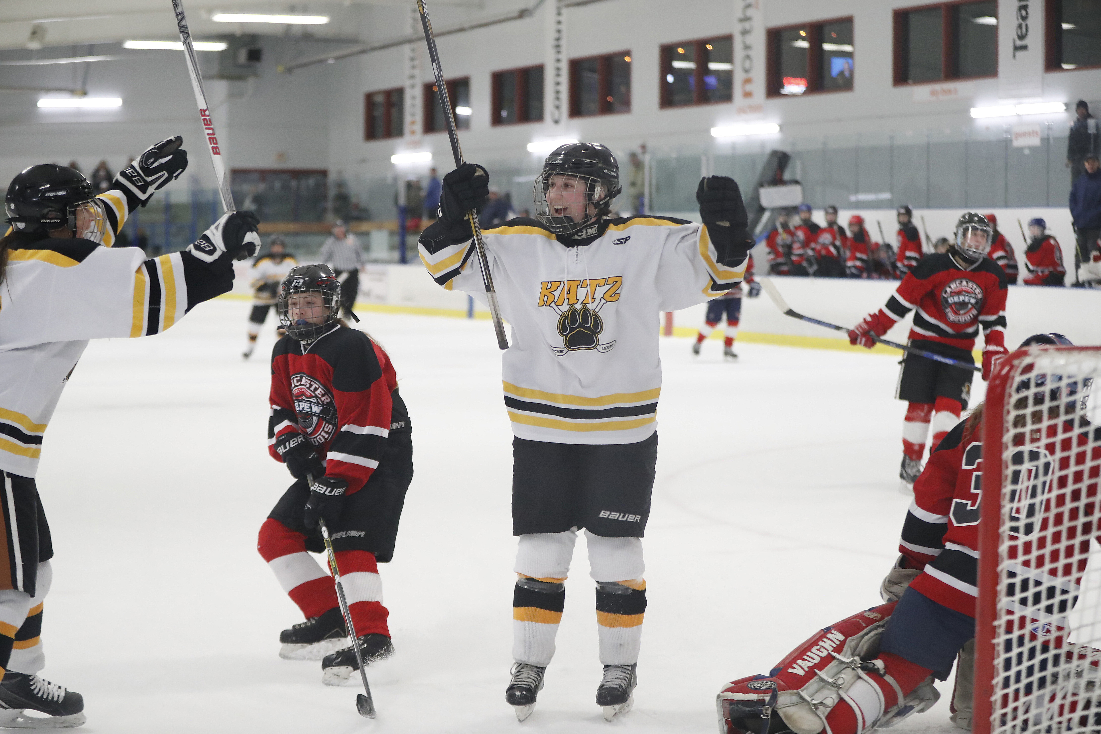 Julia Mings celebrates after scoring her 100th career goal during Clarence/Amherst/Sweet Home's girls hockey quarterfinal win over Lancaster/Iroquois/Depew during the Section VI tournament Thursday at Northtowns Center in Amherst. (Harry Scull Jr./Buffalo News)