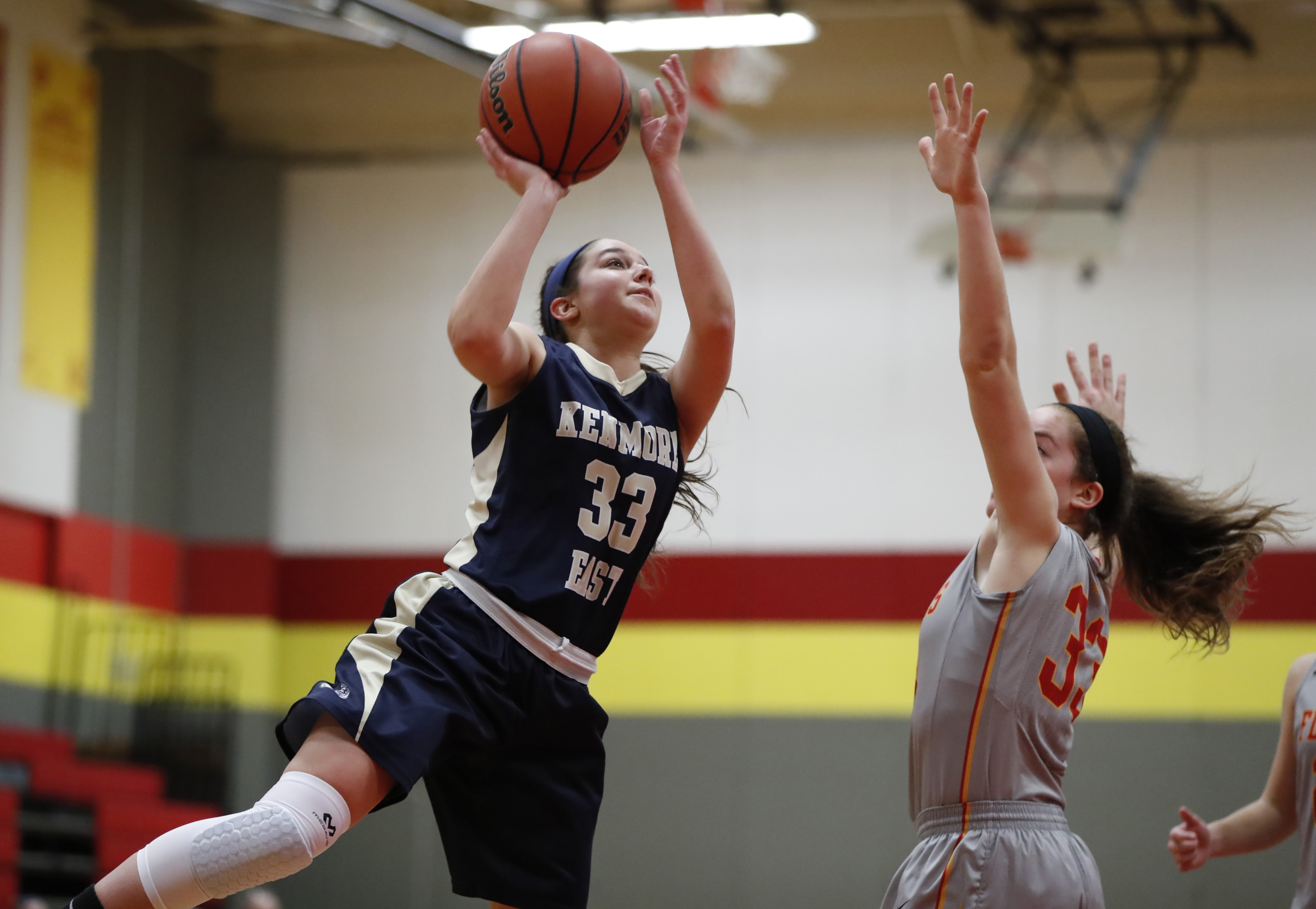 WIlliamsville East's Rachel Romanowski defends Kenmore East's Kendall Mills during first half action Wednesday. (Harry Scull Jr./Buffalo News)