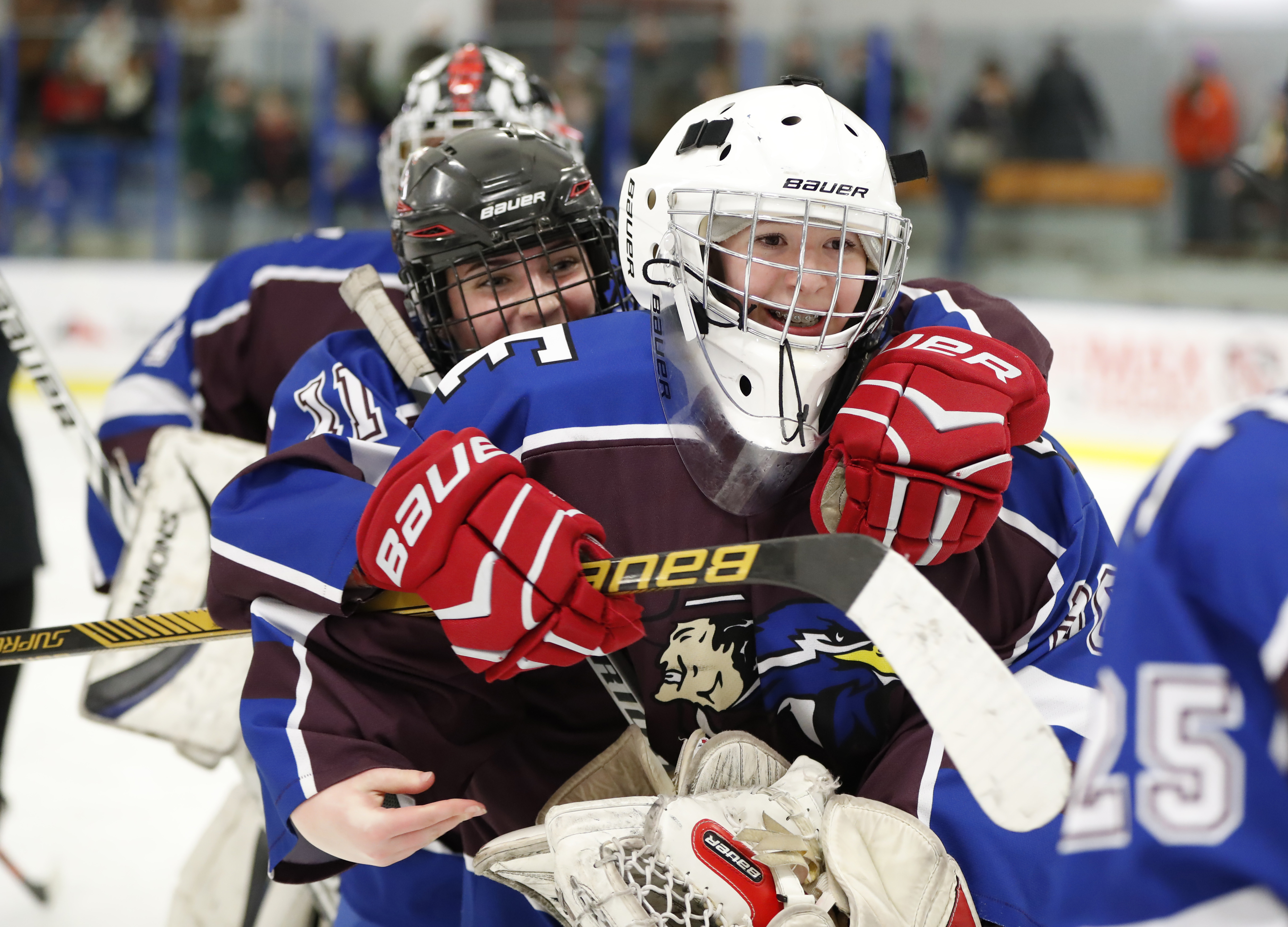 Frontier/Lancaster/Orchard Park's Meghan Roche congratulates Victoria Cottrell after FLOP ended Kenmore/Grand Island's reign as Section VI champions last week. (Harry Scull Jr./Buffalo News)