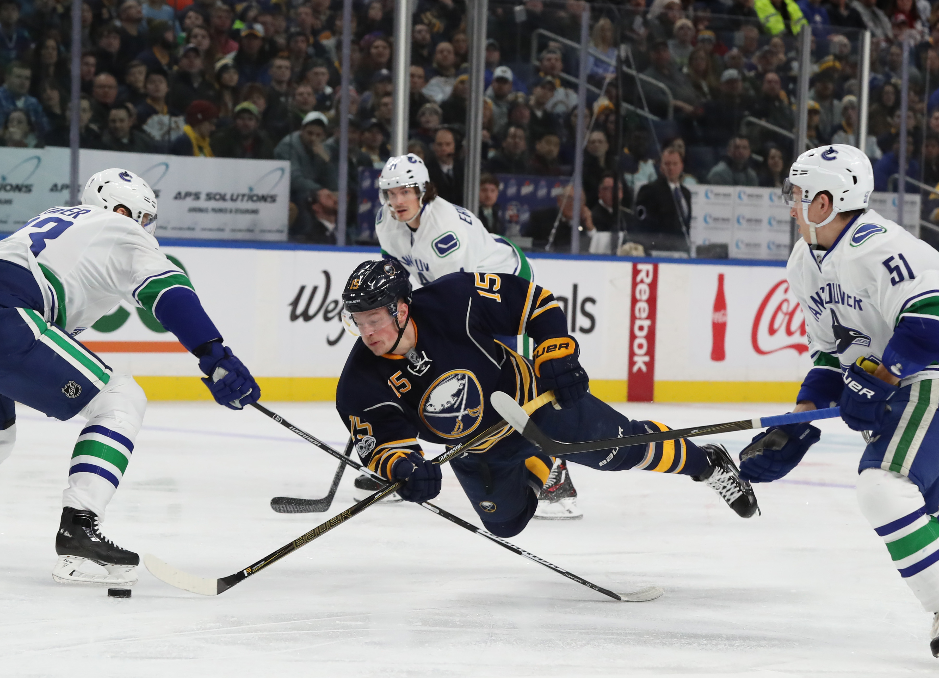 Buffalo Sabres center Jack Eichel (15) is tripped by Vancouver Canucks defenseman Alexander Edler (23) in the first period at Key Bank Center Buffalo N.Y. on Sunday, Feb. 12, 2017.  (James P. McCoy/Buffalo News)