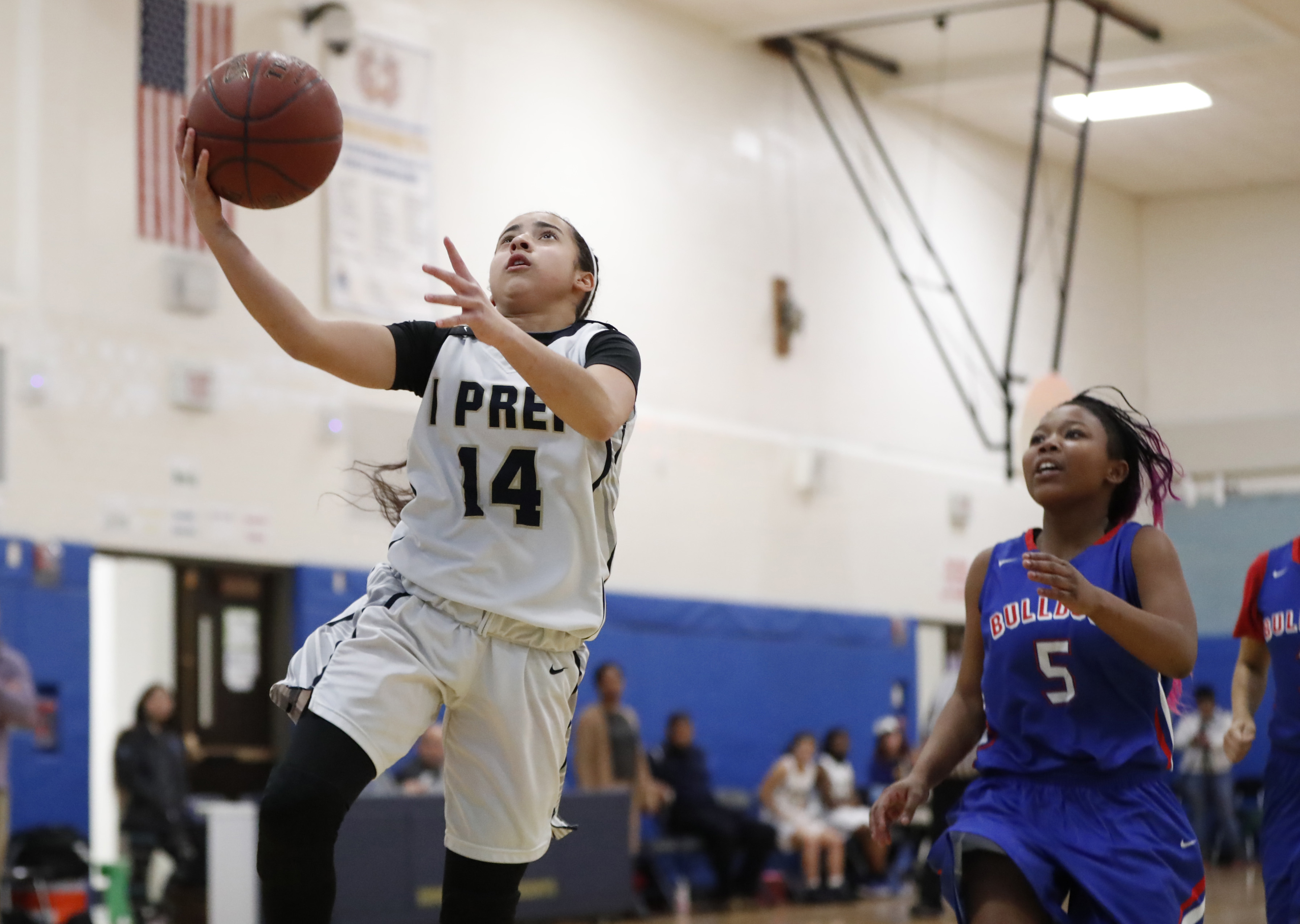I-Prep/Grover's Adeika Santana Santiago drives to the basket for two points against Burgard  during the Presidents' win on Thursday. (Harry Scull Jr./Buffalo News)