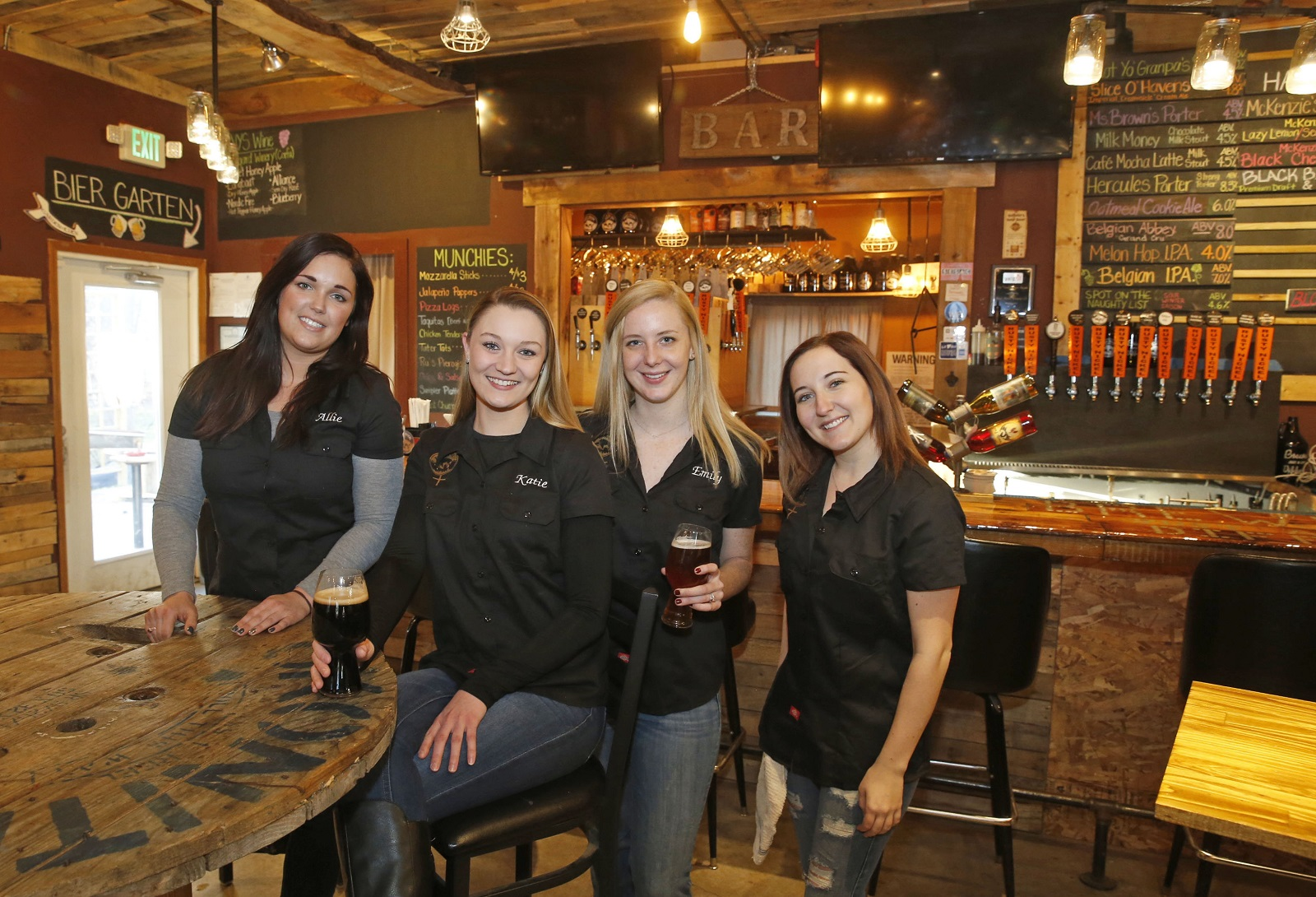 Some of the staff at the Rusty Nickel Brewing Co. that influenced the 'FemALE' series of beers. From left: assistant brewer Allie Ralbovsky, manager Katie Brown, assistant manager Emily Melski and bartender Margaret Cavese. (Robert Kirkham/Buffalo News)