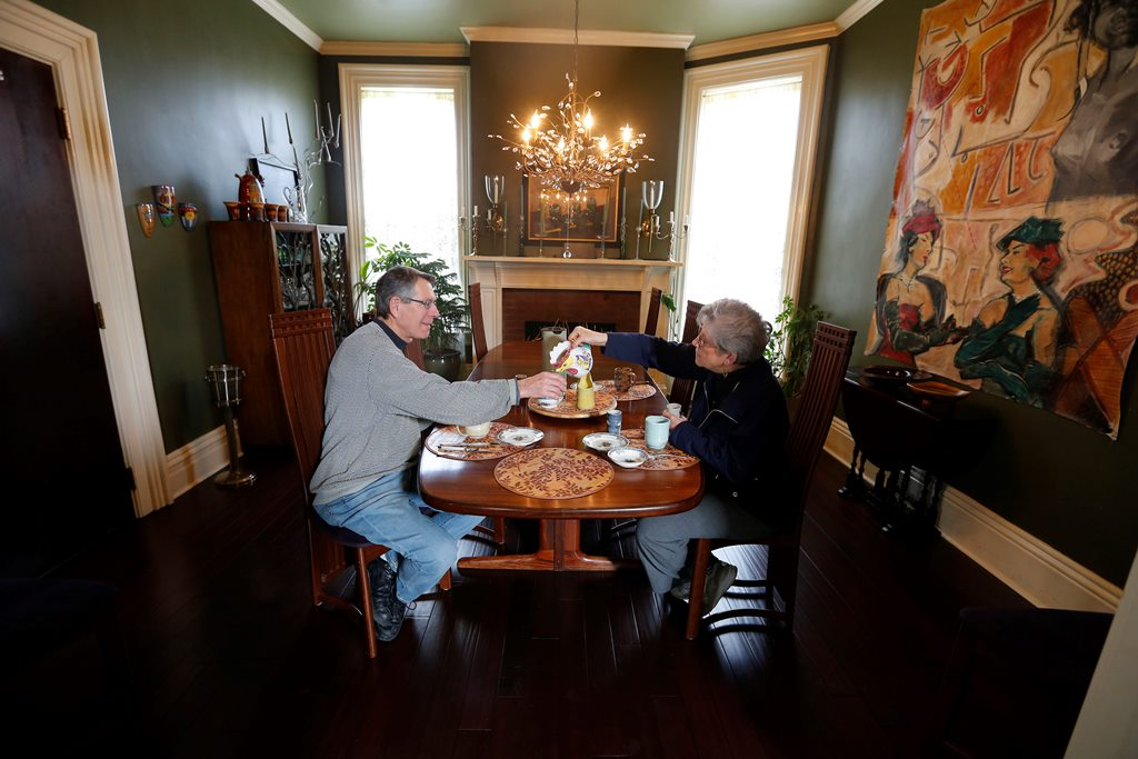 Howard and Valerie Rosenhoch enjoy breakfast at Oscar's Bed & Breakfast on Linwood Avenue in Buffalo. Operators of bed-and-breakfast facilities say Airbnb rentals have an unfair advantage because they don't follow the same rules. (Mark Mulville/Buffalo News)