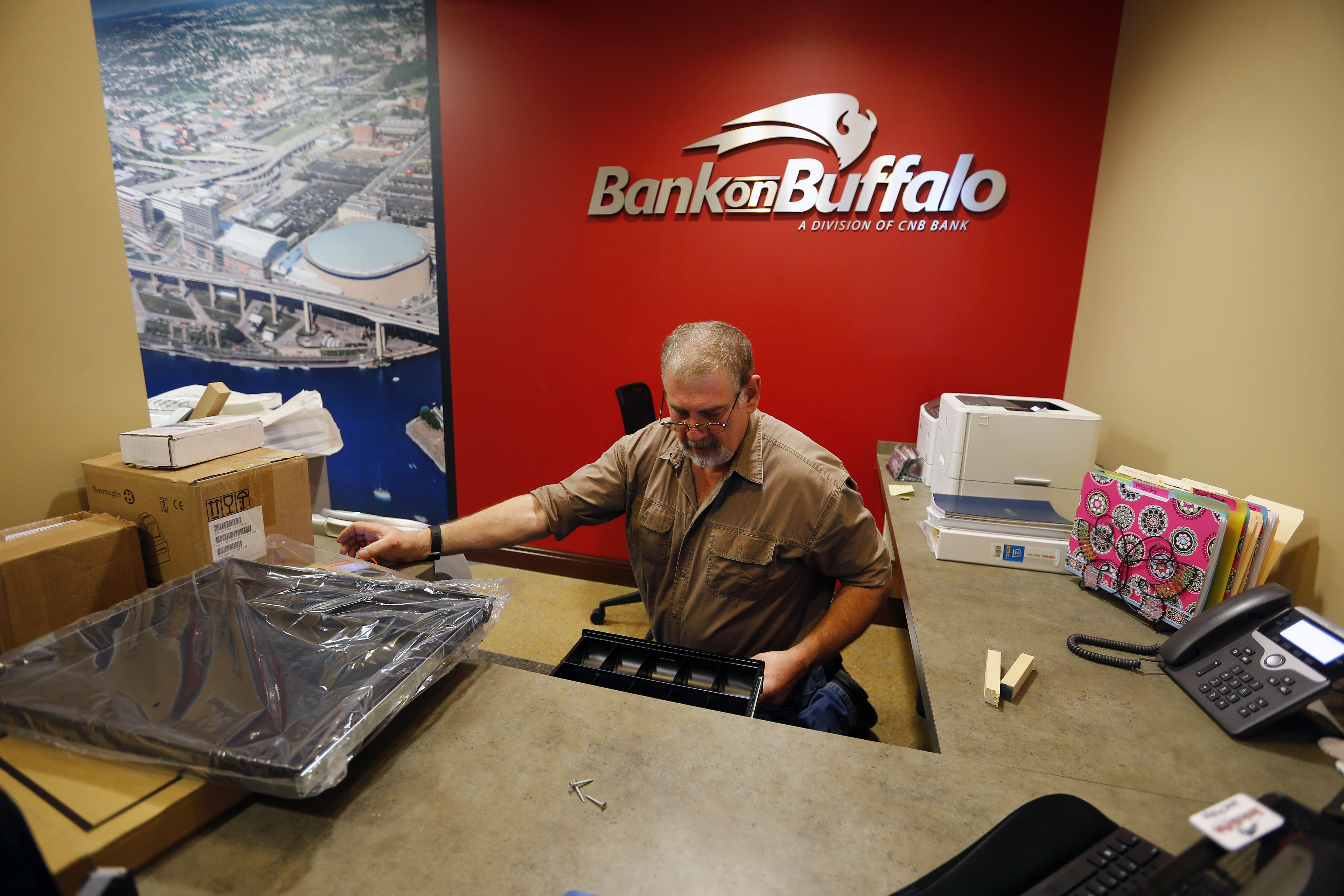 Sam Skebo installs a cash drawer as Bank on Buffalo prepares to turn its Electric Tower location into a full-service branch. (Mark Mulville/Buffalo News)