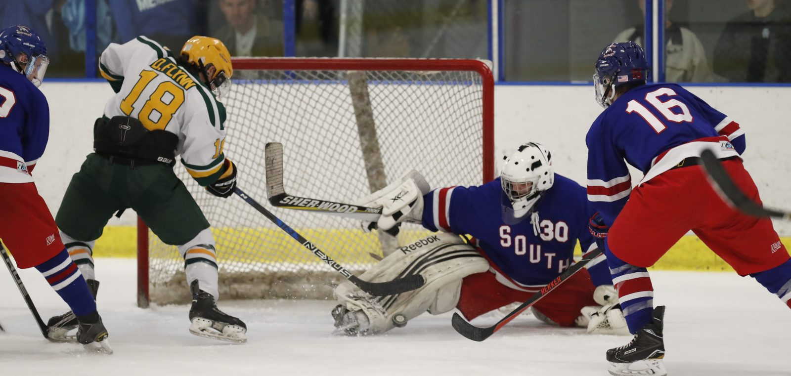 West Seneca East's Daniel Flynn is stopped by Williamsville South's Jake Kantor during second period action at Northtown Center Friday. (Harry Scull Jr./Buffalo News)