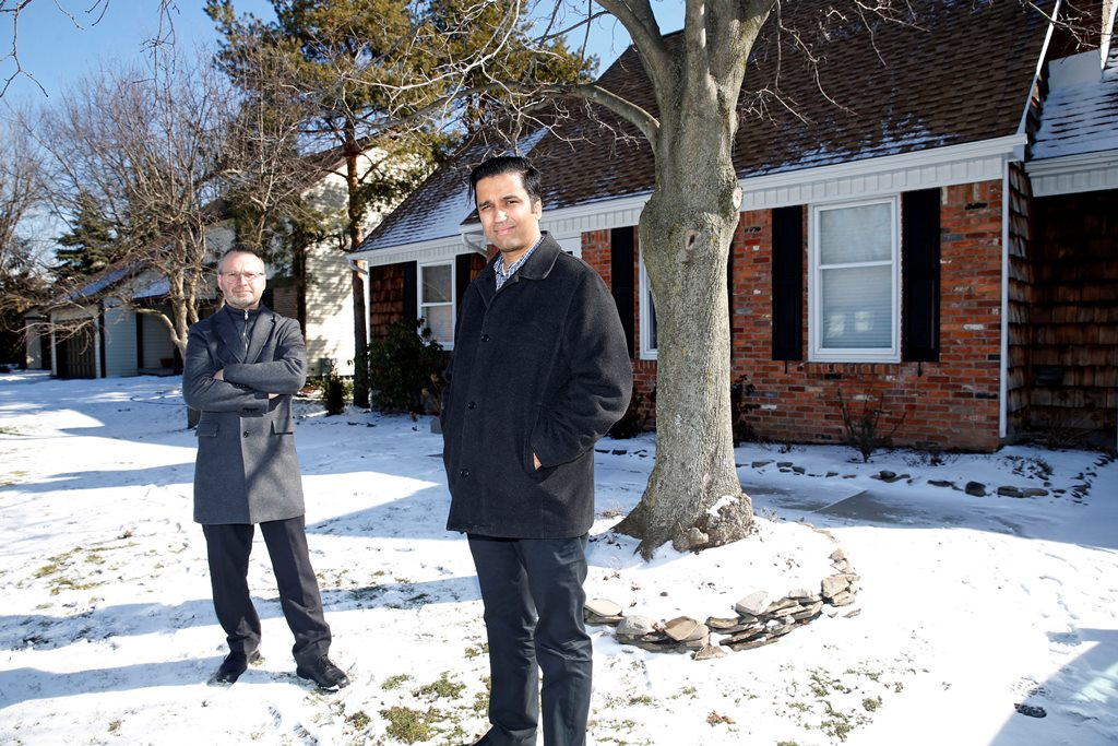 Abhi Chattopadhyay, 34, right,  was recruited to the area with his family to work for M&T Bank and last year began looking for a home in Williamsville. But low inventory in their price range of $230,000 to $330,000 meant list prices were rising and the competition often involved up to 25 offers, said their agent, Ed Golach, left.   (Robert Kirkham/Buffalo News)