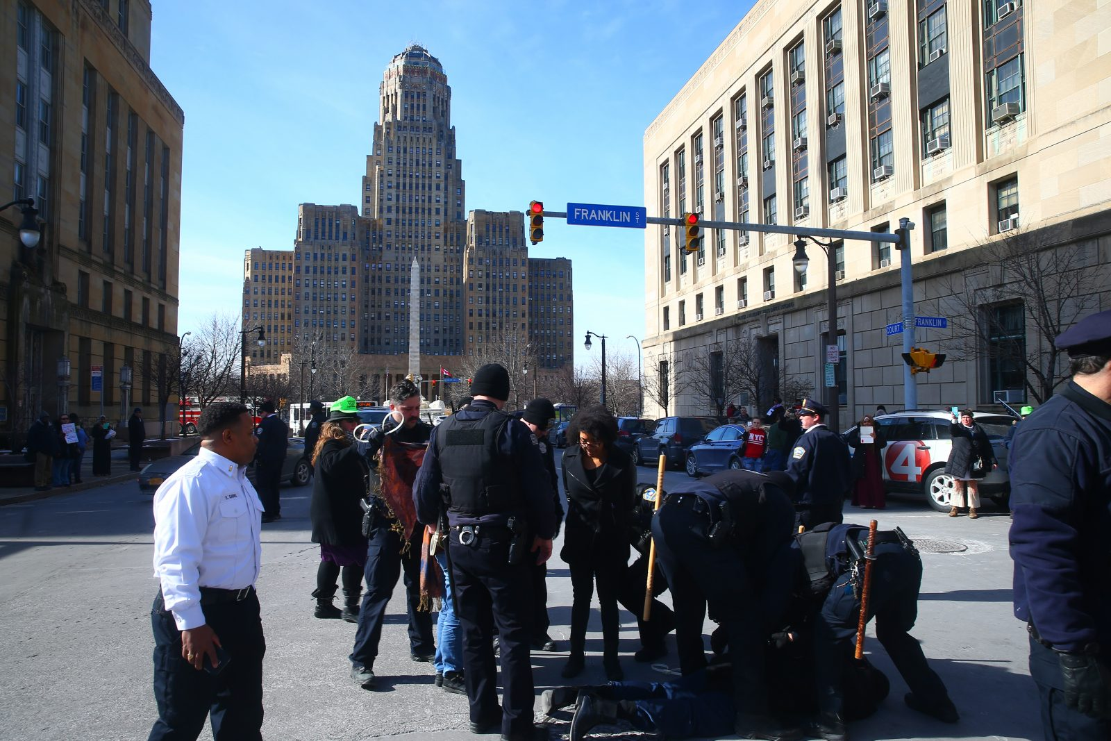 Protesters urge Mayor Byron Brown to denounce police brutality outside the Convention Center where he was giving his State of the City address Friday. Several protesters were arrested after blocking traffic in the intersection. (John Hickey/Buffalo News)