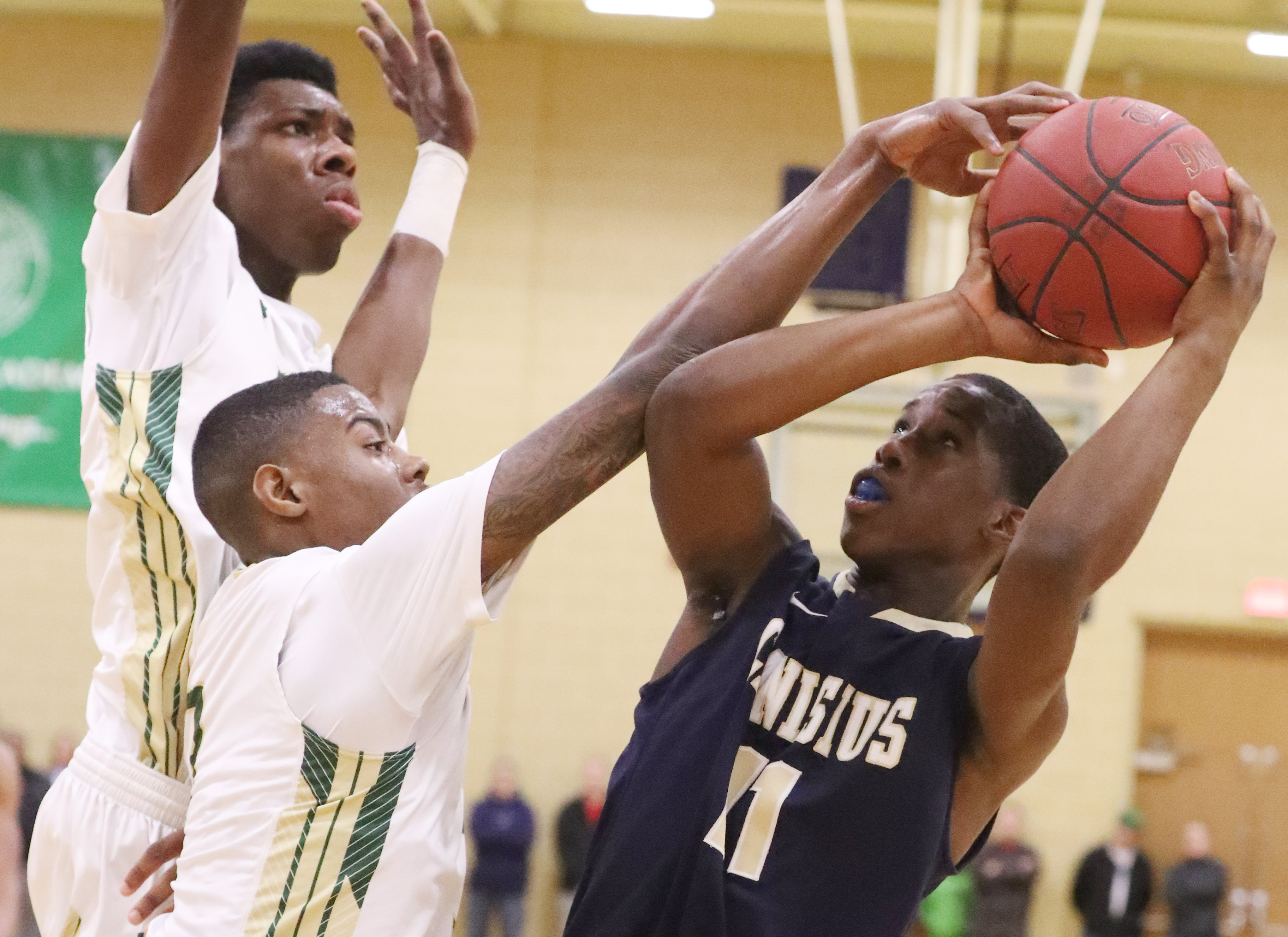 Canisius' Joe Jamison proved to be one of many difference-makers for the Crusaders in their Manhattan Cup Class A semifinal win over Bishop Timon-St. Jude on Saturday night at Villa Maria College.  (James P. McCoy/Buffalo News)