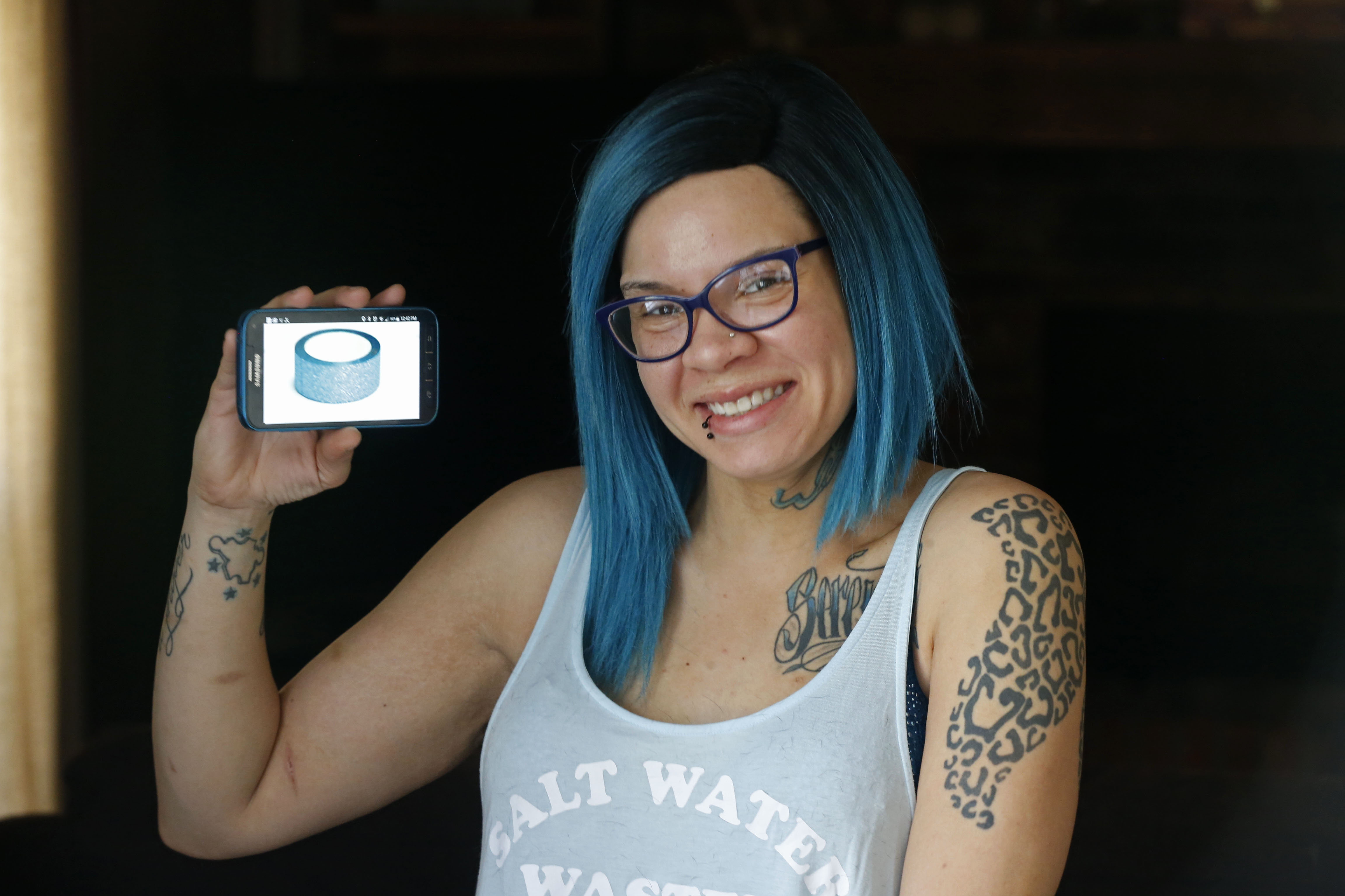 Brittany Brown, age 28, of East Amherst. A baker, tattoo artist and former pizzeria owner. Brown still shops in stores for things like clothing and craft supplies. (Robert Kirkham/Buffalo News)