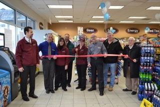 Crosby's executives and vendor partners cut the ribbon on the Albion store. From left to right are Dan Okun, Darrin Barber, Janice Hunt, Raz Rahman, Valerie Storie, Doug Galli, Doug McIvor and John Mills. (Contributed photo)