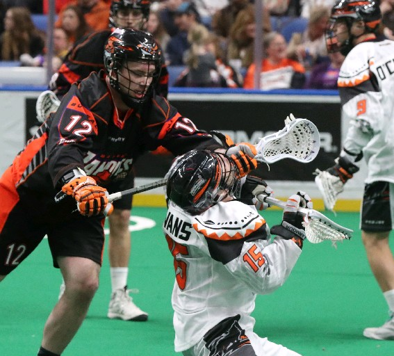 Mitch de Snoo (left), shown here checking Shawn Evans of New England on Friday, scored the game-winner in Sunday's game with the Black Wolves. (James P. McCoy / Buffalo News)