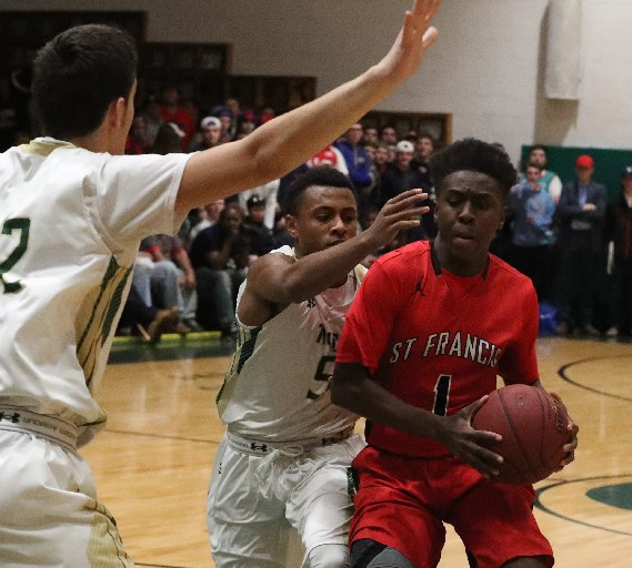 Bishop Timon/St. Jude's Juston Johnson guards St. Francis' Julian Cunningham in the first half of Tuesday's game. (James P. McCoy / Buffalo News)