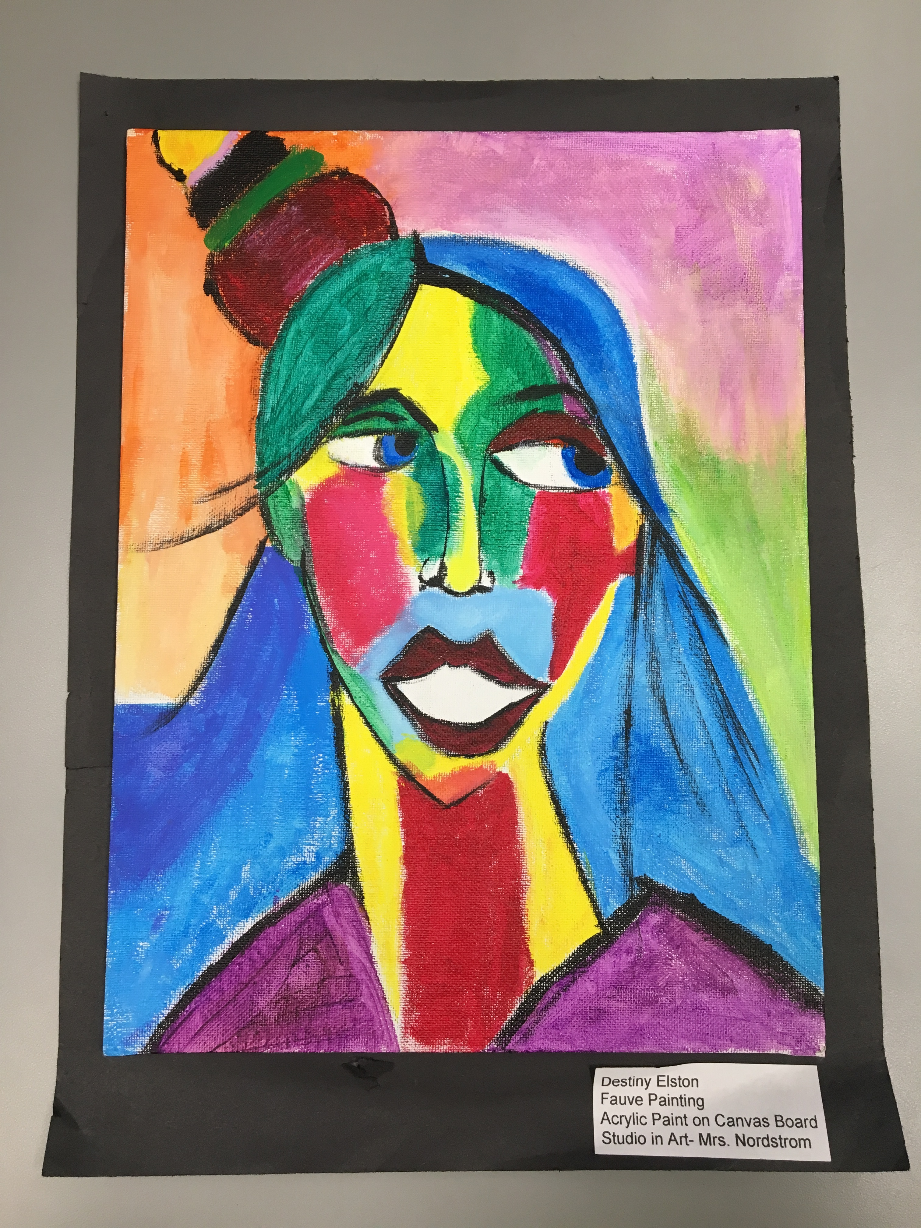 This acryllic paint on canvas was created by Destiny Elston. It is part of the exhibit in Cheektowaga that showcases student artists.