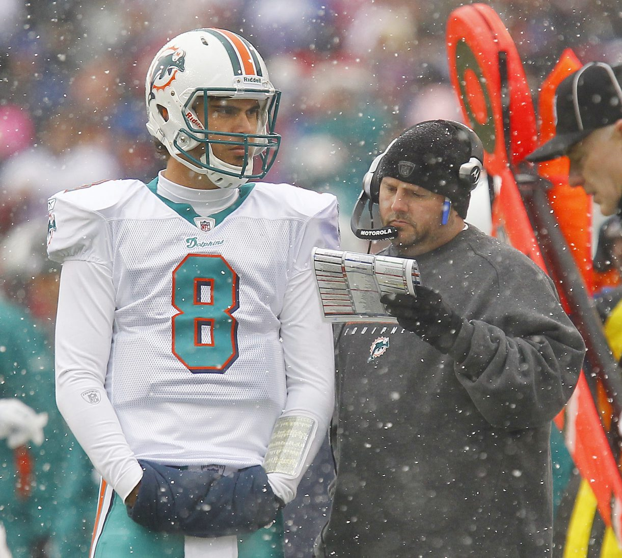 Brian Daboll, during his tenure as offensive coordinator for the Miami Dolphins, consults with quarterback Matt Moore during a game at the Bills on Dec. 18, 2011. (Mark Mulville/Buffalo News)