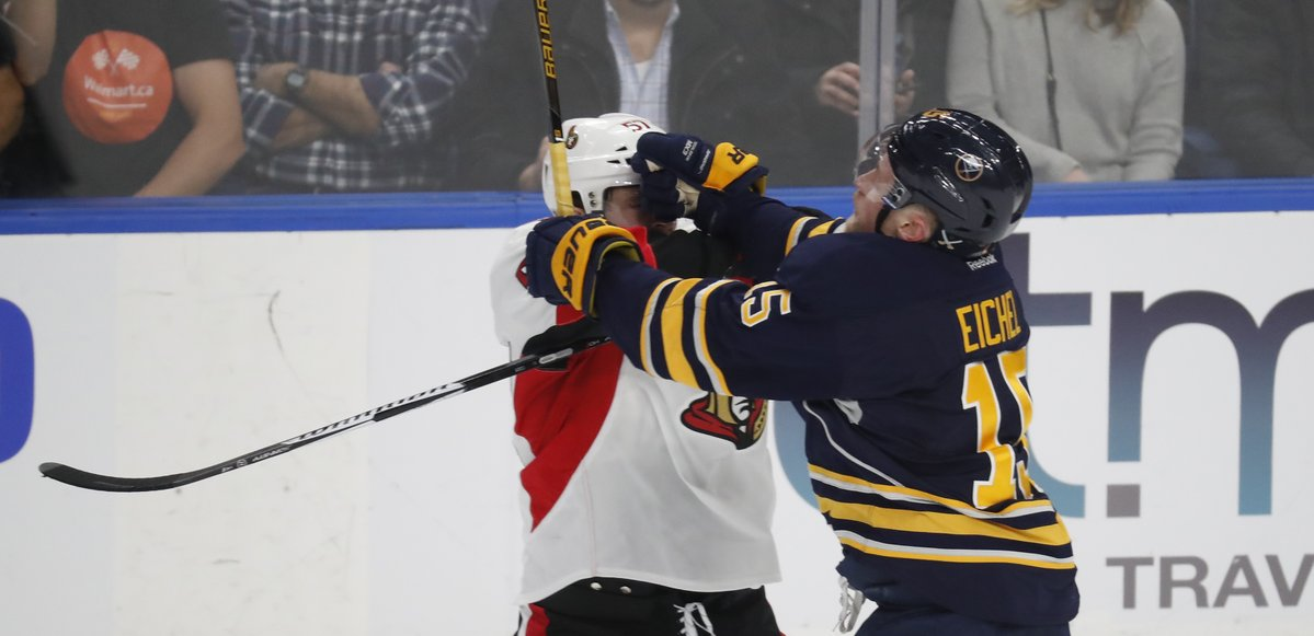 Jack Eichel battles with Ottawa's Tommy Wingels (Harry Scull Jr./Buffalo News).