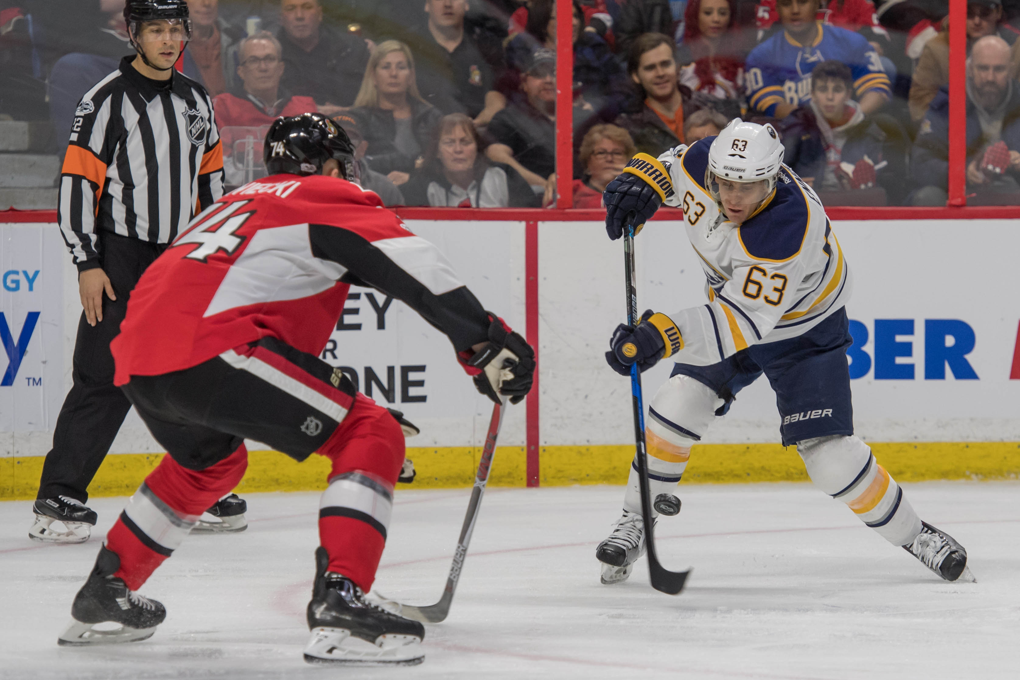 Sabres winger Tyler Ennis shoots past Ottawa defenseman Mark Borowiecki. (Marc DesRosiers-USA TODAY Sports).