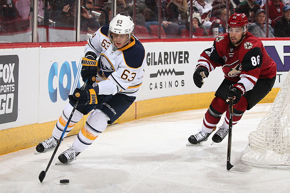 Tyler Ennis works against Arizona's Josh Jooris during second-period action (Getty Images).