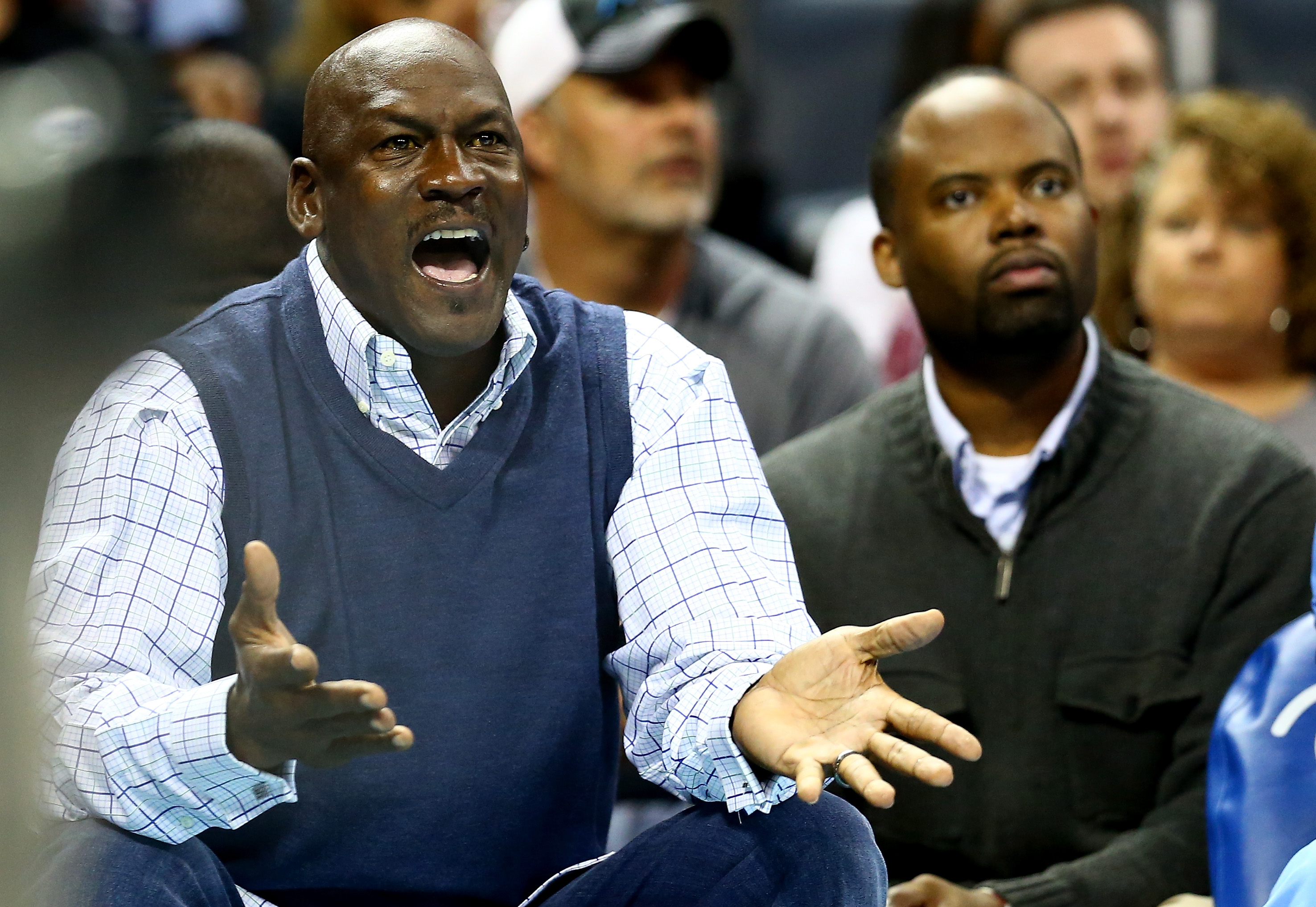 Charlotte Hornets owner Michael Jordan reacts to a call against his team. (Getty Images)