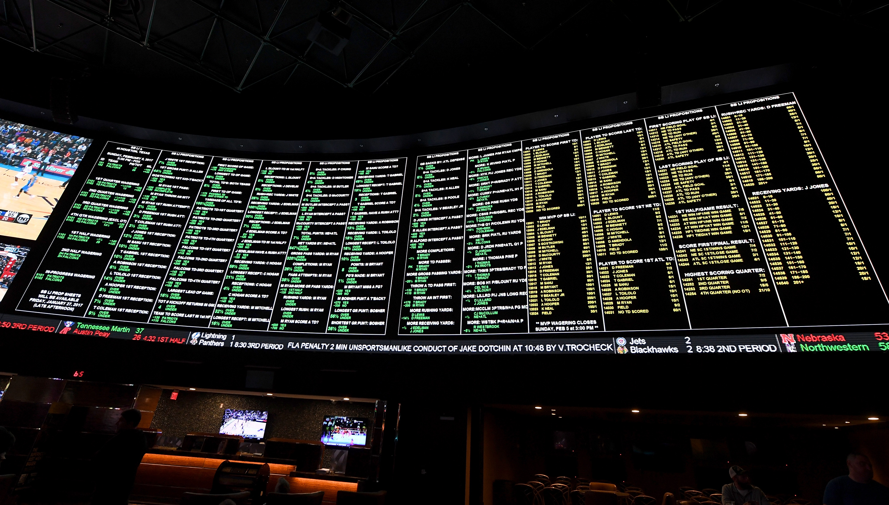The betting line and some of the more than 400 proposition bets for Super Bowl LI between the Atlanta Falcons and the New England Patriots are displayed at the Race & Sports SuperBook at the Westgate Las Vegas Resort & Casino. (Getty Images)