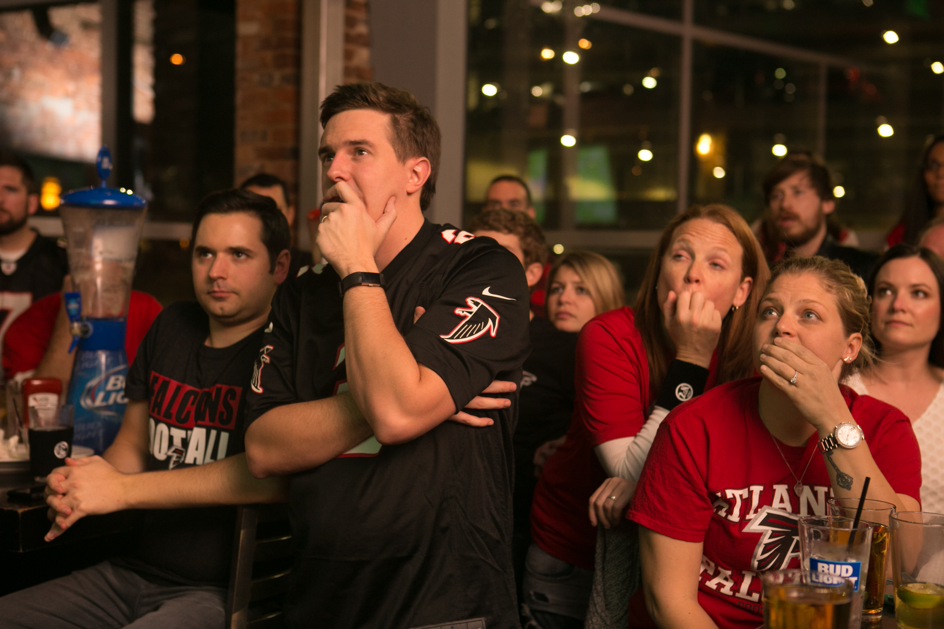 Falcons fans react while watching Super Bowl LI at an Atlanta bar. (Getty Images)