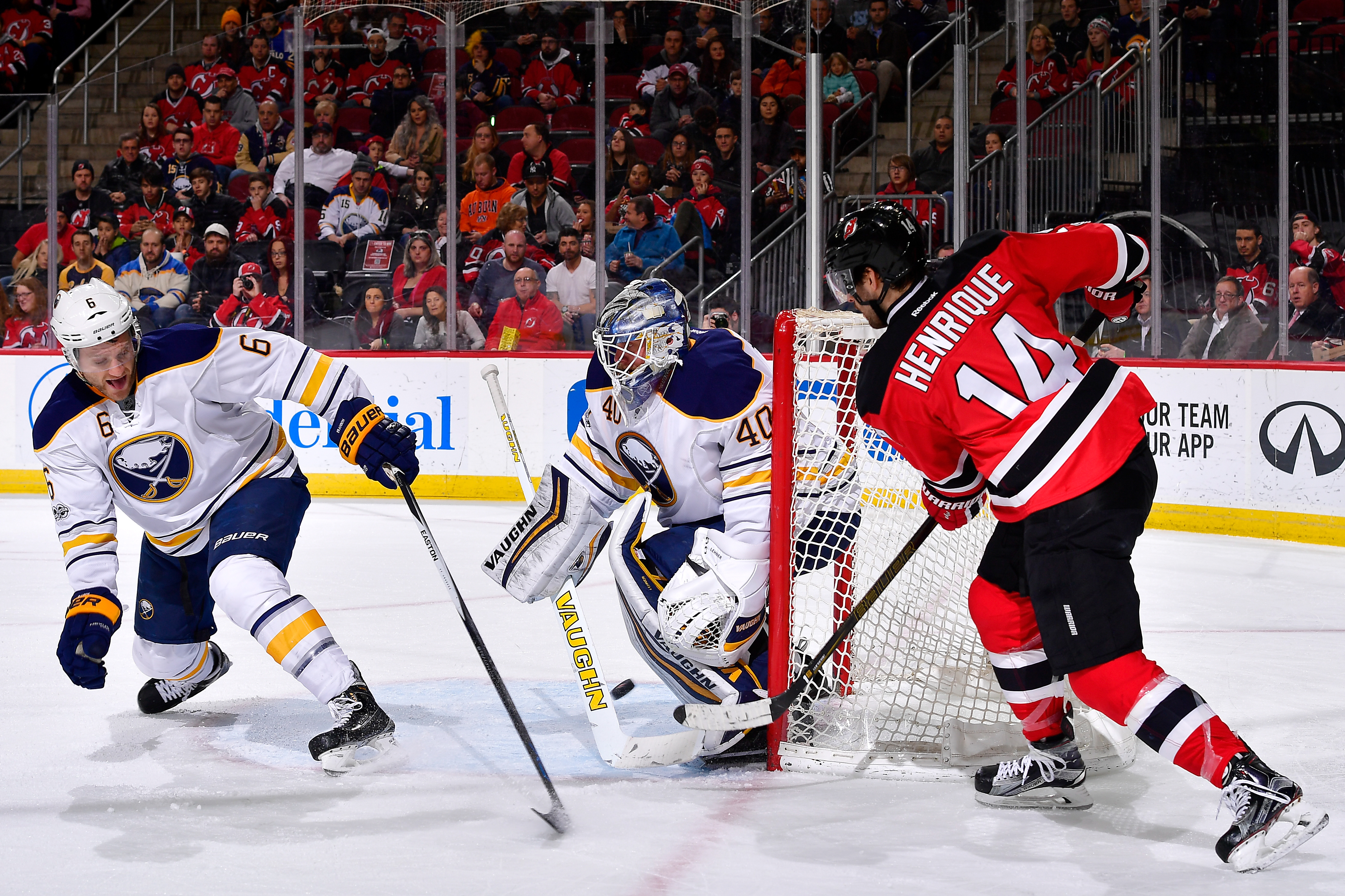 The Devils' Adam Henrique opened the scoring by banking the puck off the Sabres' Cody Franson.  (Getty Images)