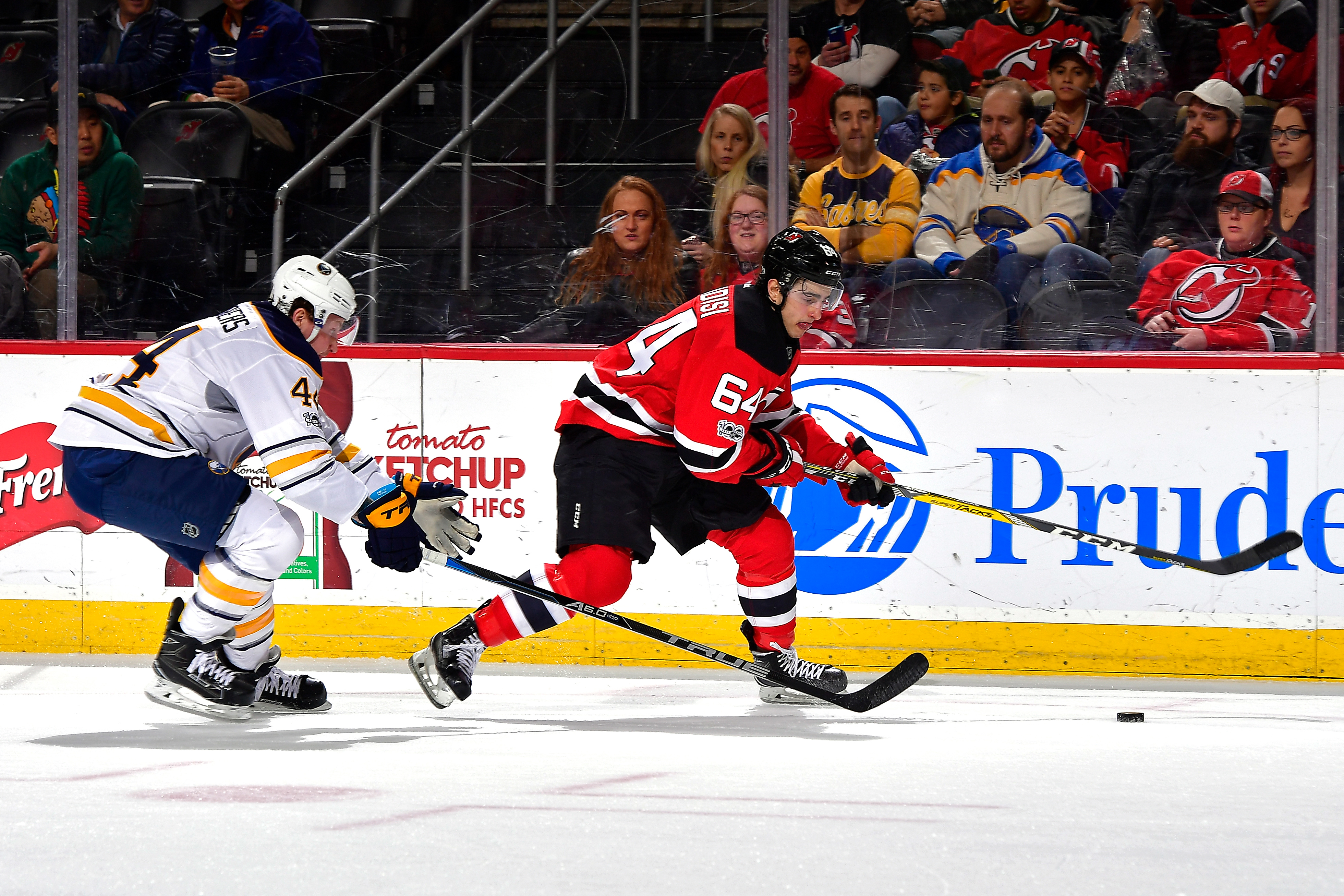 Joseph Blandisi and the Devils were a step ahead of Nicolas Deslauriers and the Sabres. (Getty Images)