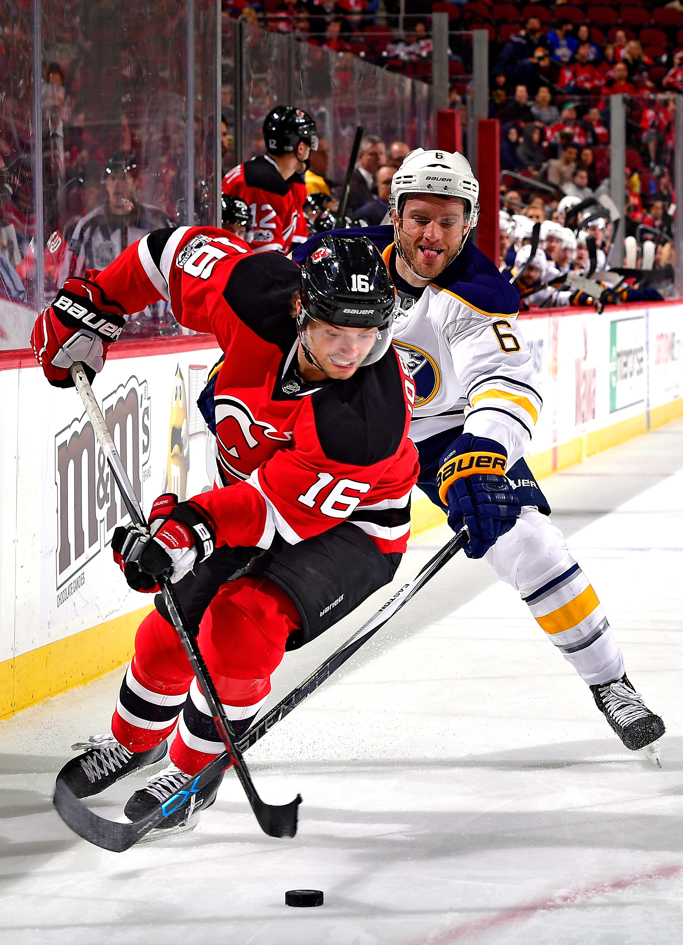 The Sabres' Cody Franson, jostling with New Jersey's Jacob Josefson, is a potential trade-deadline piece. (Getty Images)