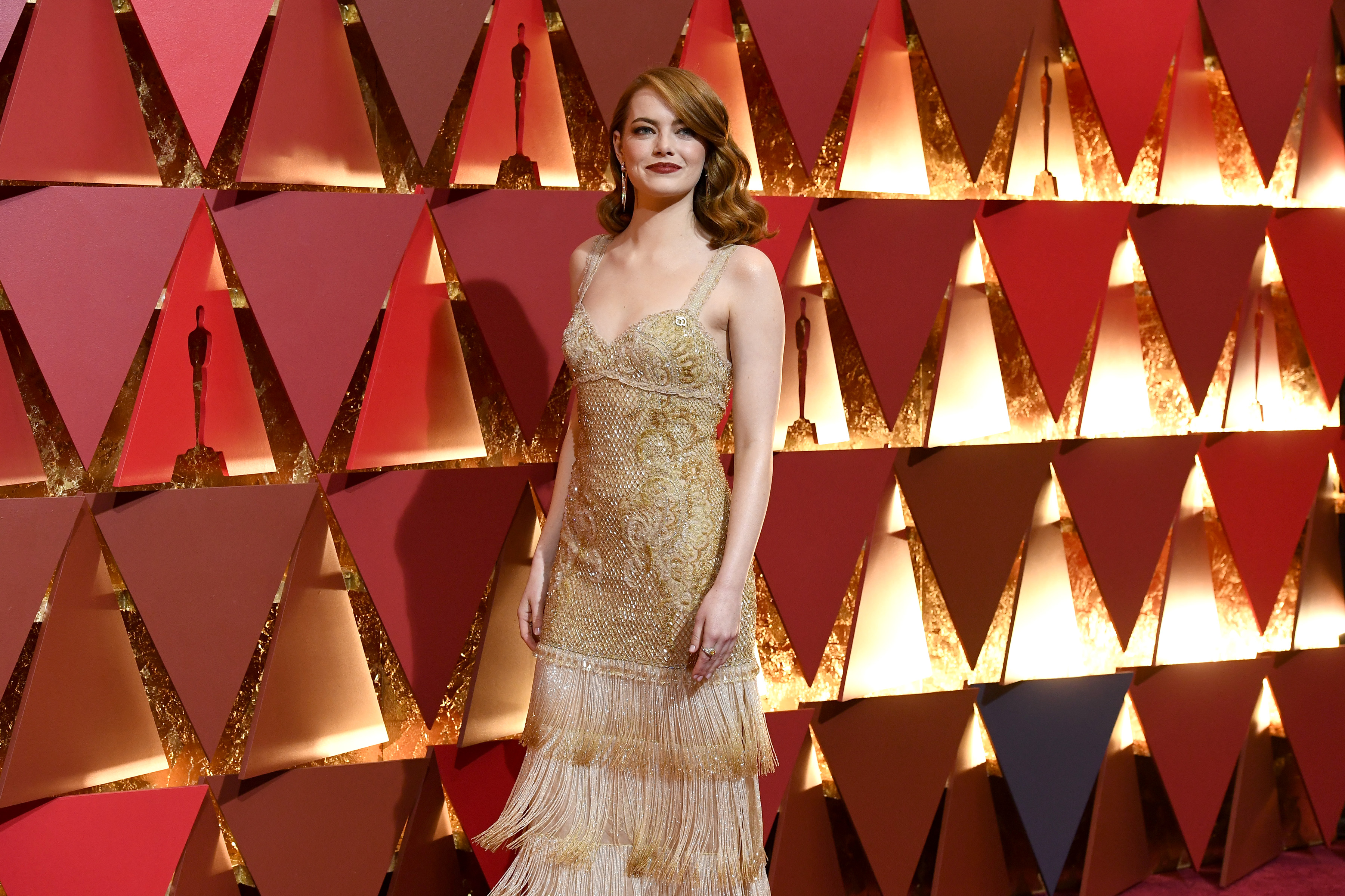 Emma Stone was one of several actresses who wore gold to the Oscars Sunday night. This one may top the list. (Getty Images)