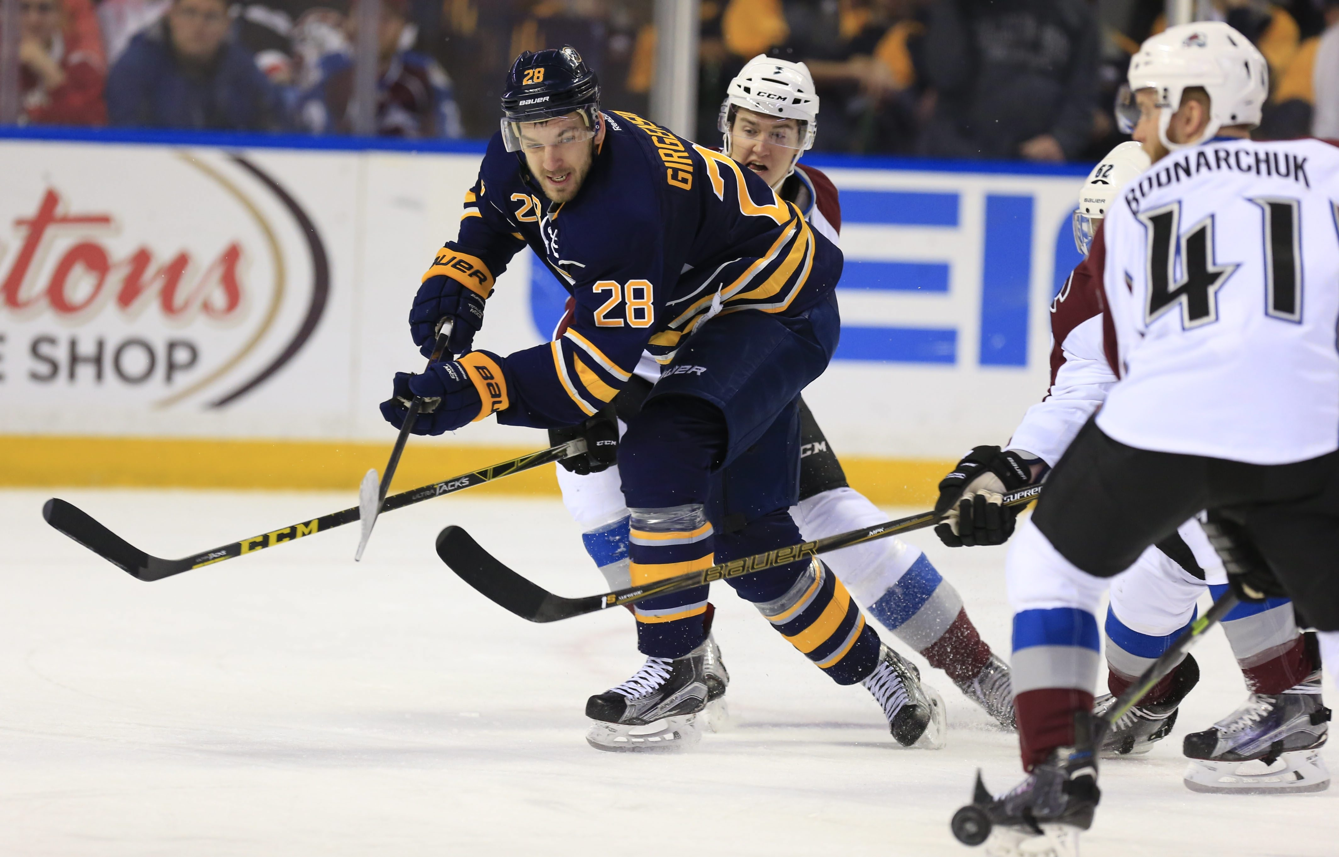 Zemgus Girgensons, shown facing the Colorado Avalanche last season, will return to the lineup from injury to face the Avs on Saturday (Harry Scull Jr./Buffalo News file photo).