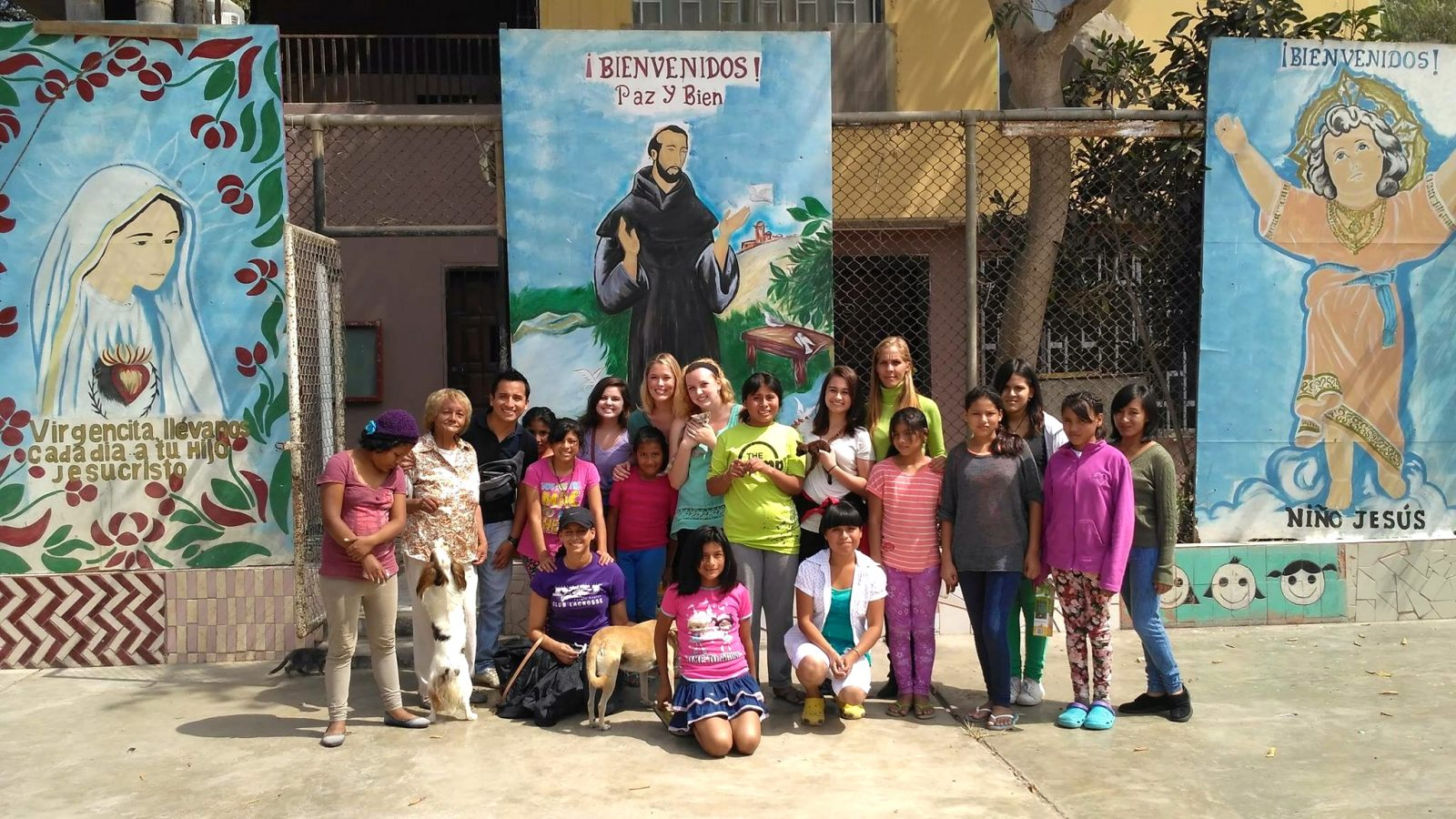 Niagara University students volunteer at 'Hogar de Acogida Caritas Felices' which loosely means 'Welcome Home Happy Little Faces.' The self-sustaining charity in Lima, Peru, cares for girls who have been abandoned or abused. The charity is run by Mónica Quintanilla, in the back row wearing a green turtleneck.(Photo courtesy of Monica Smith)