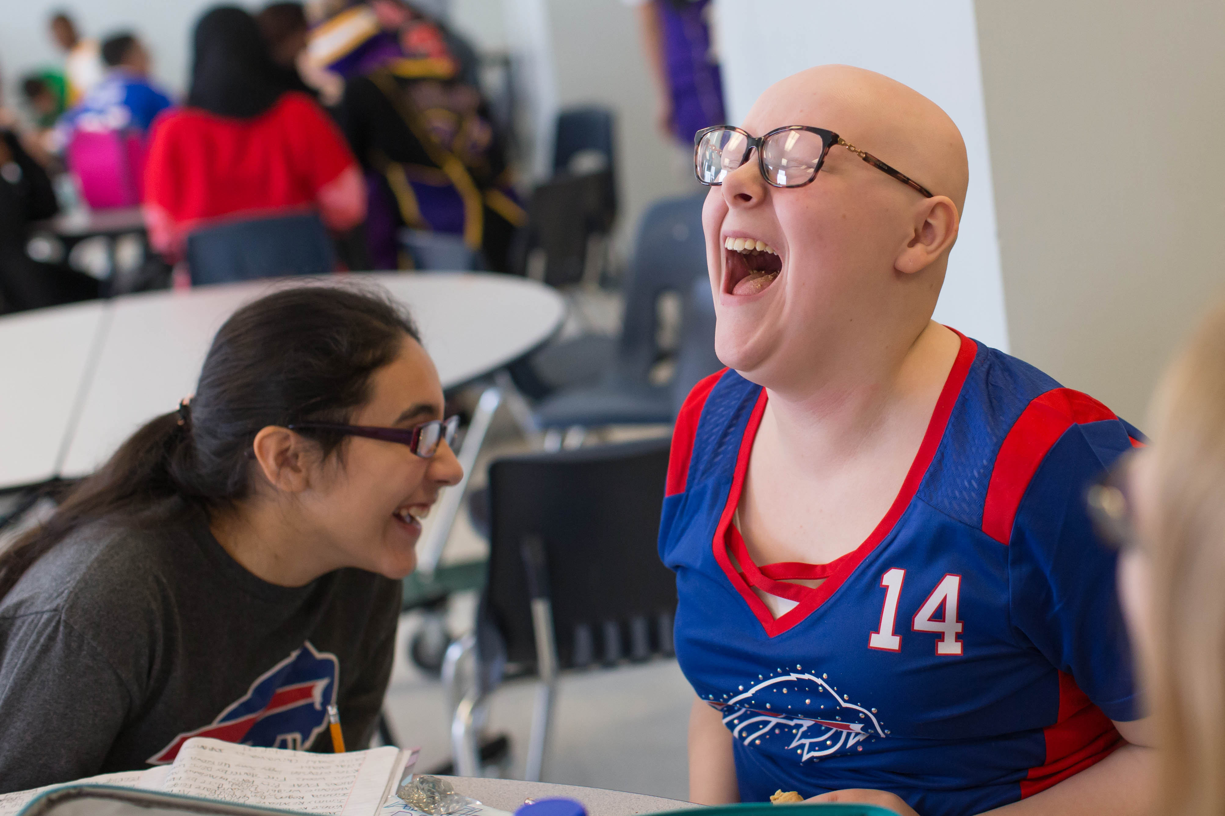 Twelve-year-old Katrina Racine, of Lackawanna,  laughs at a joke while having lunch with her friends in the cafeteria at Global Concepts Charter School in Lackawanna on  Thursday, Feb. 16, 2017.  Katrina has alopecia, a disease which caused her to lose her hair when she was 7.  (Derek Gee/Buffalo News)