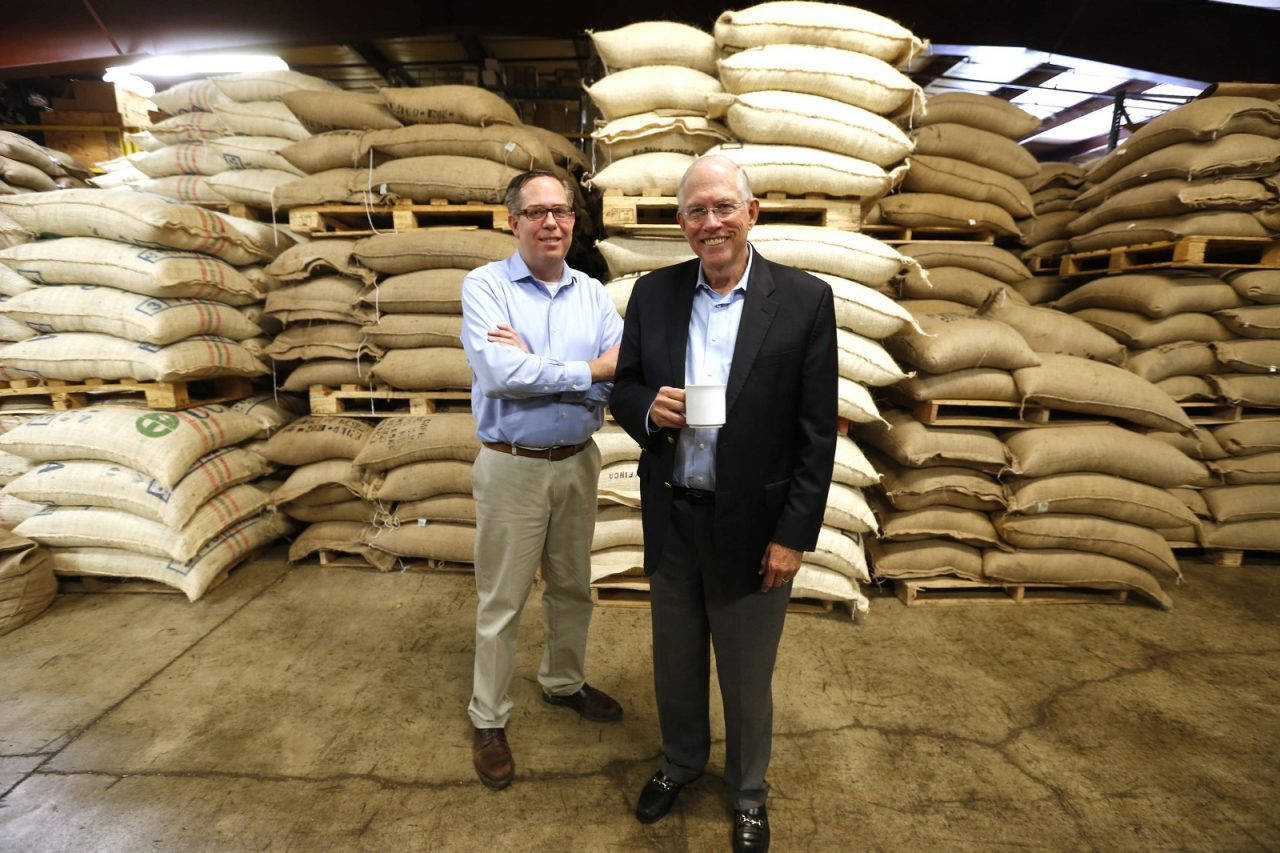 Warren Emblidge III, left, took over in 2014 as president of McCullagh Coffee from his father, Warren Emblidge Jr. They're pictured at the company's Swan Street location. (Robert Kirkham/Buffalo News)