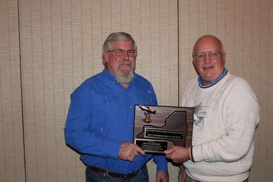 Mike Clancy, left, presents Chuck Godfrey with a special award.