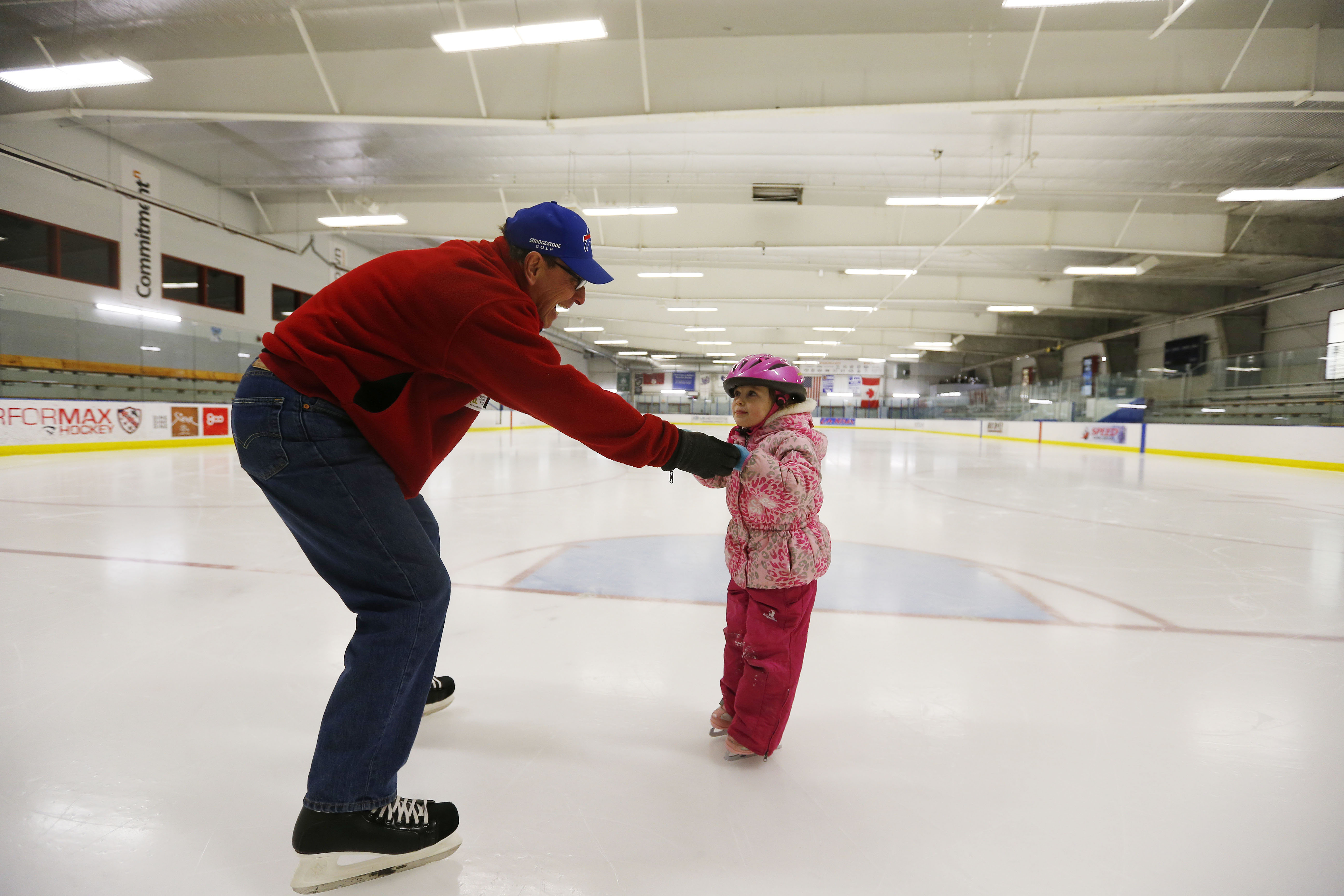 Constance Otis ice skates with her grandfather Dave Borchard at the Northtown Center in Amherst on Thursday, Feb. 9, 2017. (Mark Mulville/Buffalo News)
