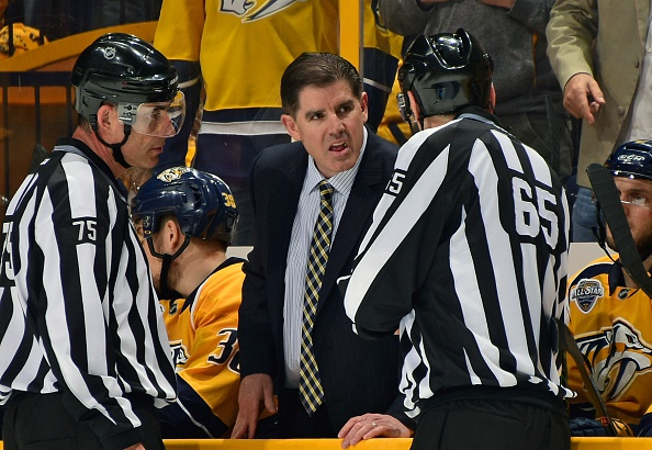 Nashville coach Peter Laviolette argues with linesmen after an offside challenge didn't go his way during a playoff series last year vs. San Jose (Getty Images).
