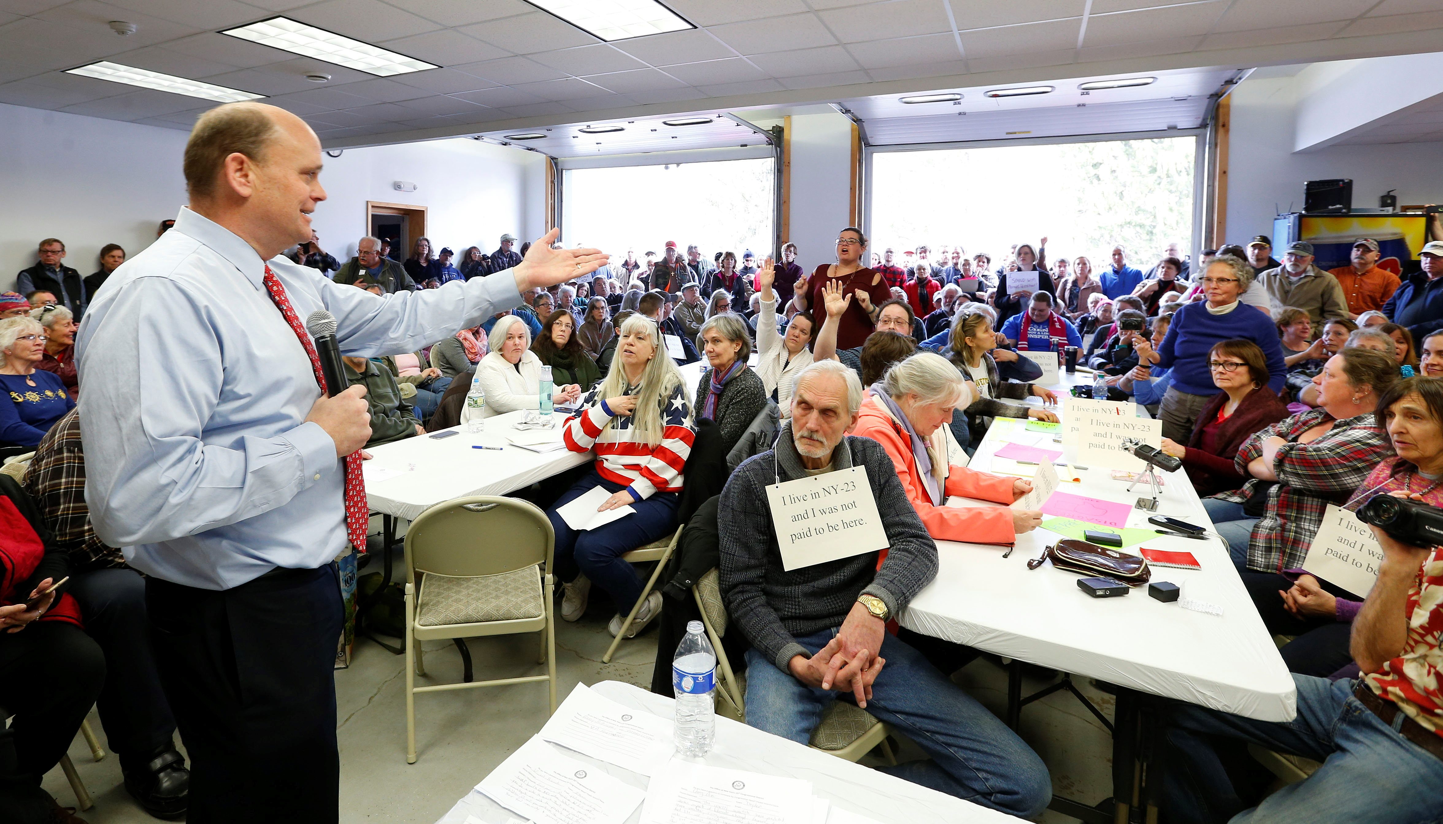 Rep. Tom Reed met with hundreds of constituents, some of them angry, Saturday at four town hall meetings, including this one at the Humphrey Fire Department in Great Valley. (Mark Mulville/Buffalo News)