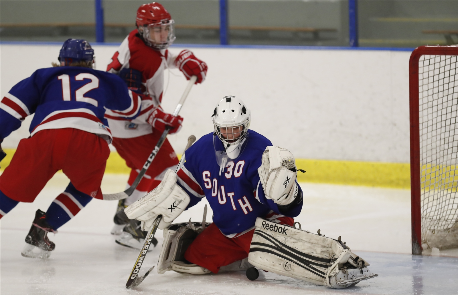 Williamsville South goaltender Jake Kantor makes a save on St. Francis during first period action Saturday. (Harry Scull Jr. / Buffalo News).