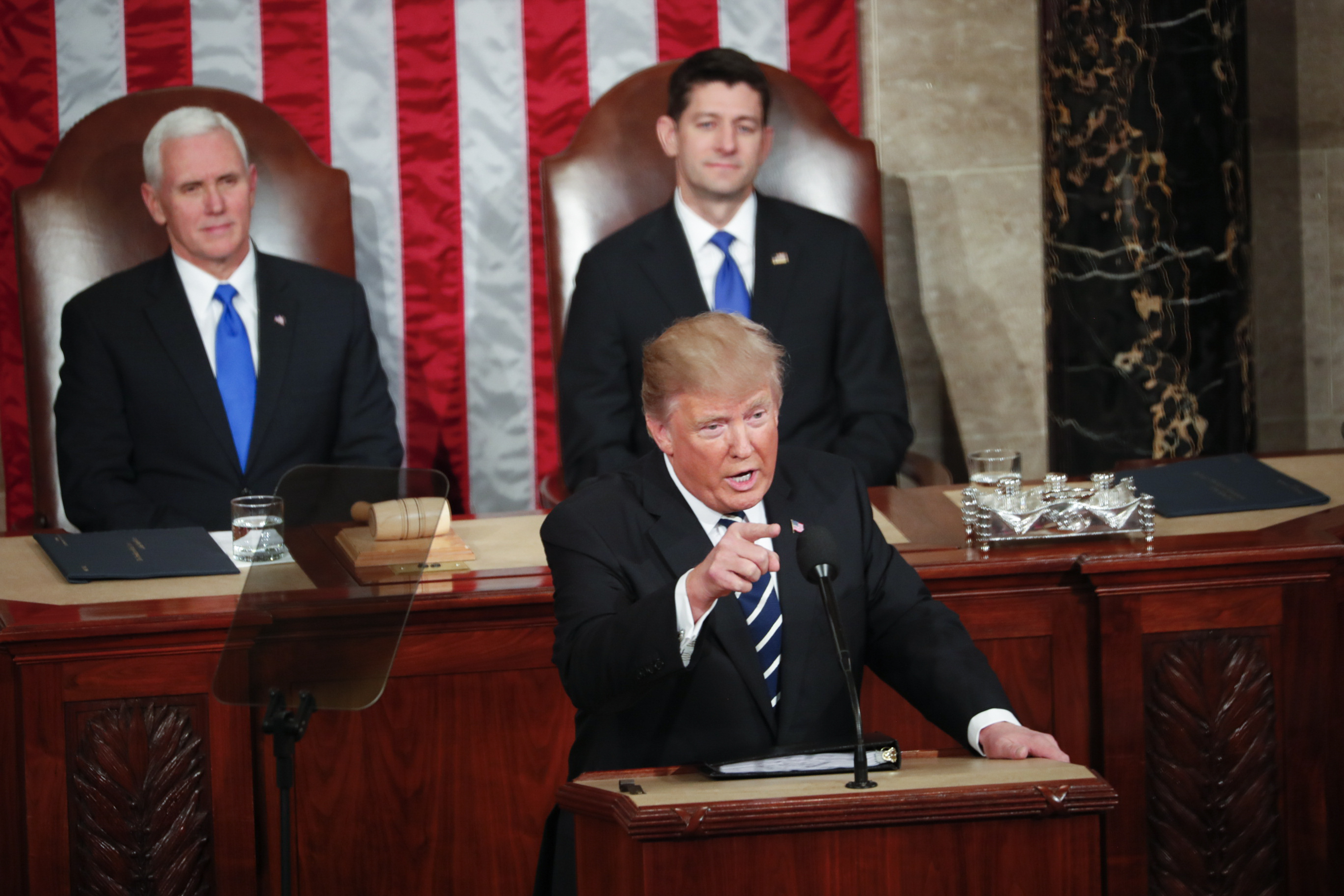 President Donald Trump, backed by Vice President Mike Pence and House Speaker Paul Ryan (R-Wis.), speaks to a joint session of Congress at the Capitol in Washington, Feb. 28, 2017. (New York Times)