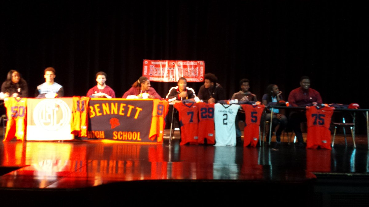 Student-athletes take part in a signing ceremony at Bennett High School on Wednesday. They won't be the last Bennett athletes to have a chance to take their talents to college, according to two school district officials.