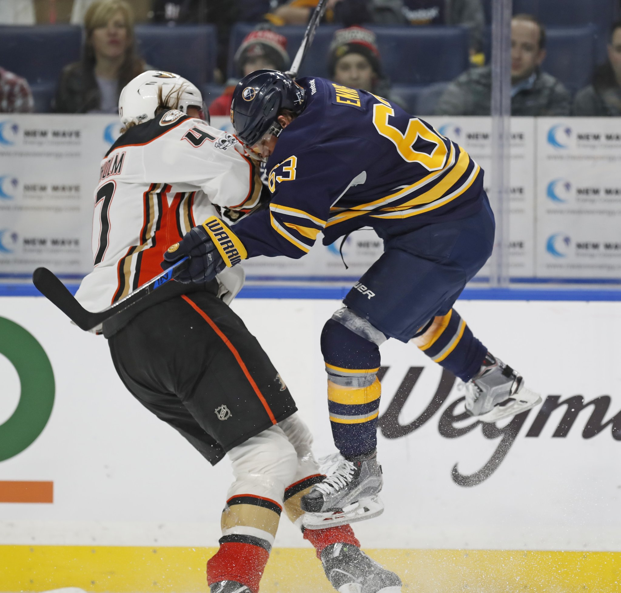 The Sabres' Tyler Ennis puts a big hit on Anaheim's Hampus Lindholm. (Harry Scull Jr./Buffalo News)