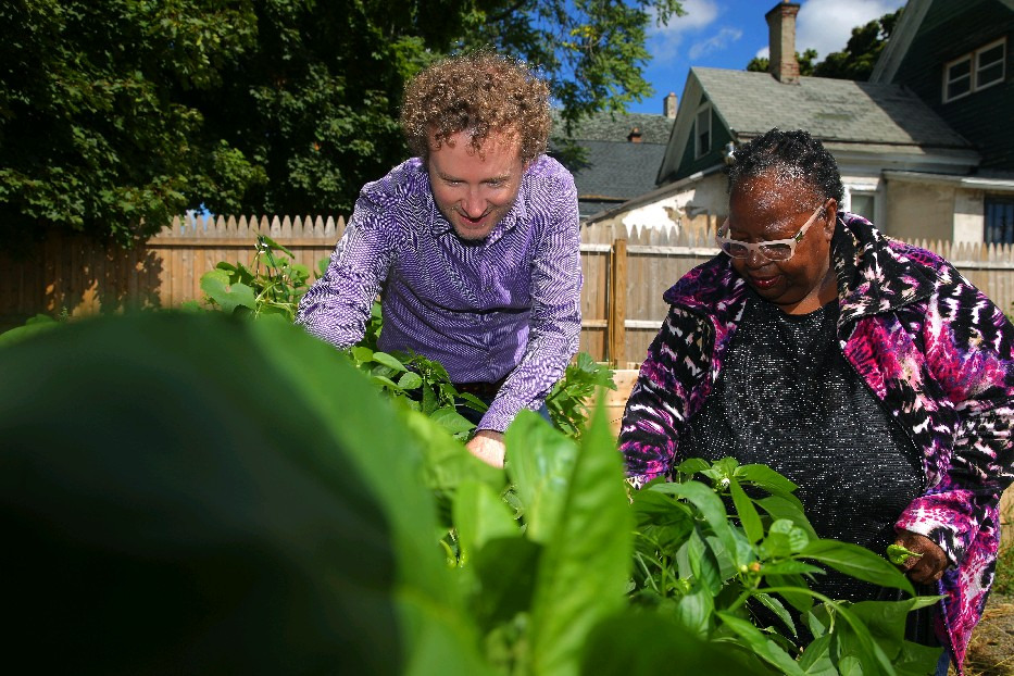 Jonathan McNeice of BNMC Inc. works fall with Rosemary Wilson, a senior volunteer, in the  community garden at The Moot Community Center in the Fruit Belt. (John Hickey/Buffalo News file photo)