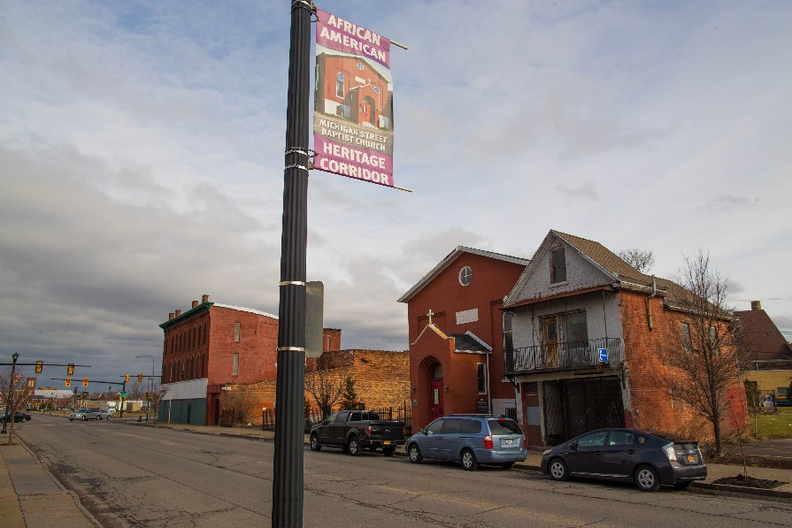 Banners denoting the African-American Heritage Corridor hang on light standards on Michigan Avenue, across from the Michigan Street Baptist Church, center, a famous stop on the Underground Railroad. (Derek Gee/Buffalo News)