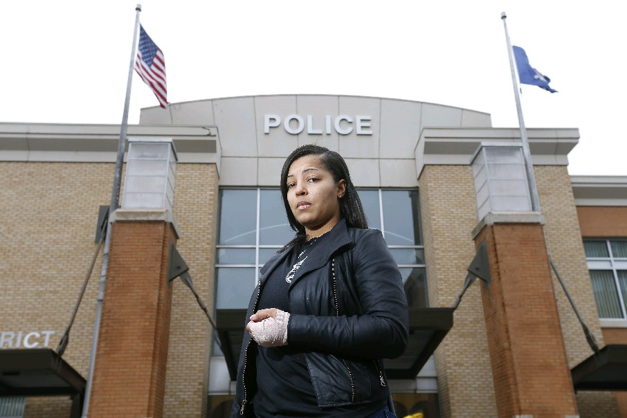 Buffalo Police Officer Jasmine R. Olmstead, who was injured responding to a call of a man high on drugs, stands in front of the B District station in Buffalo