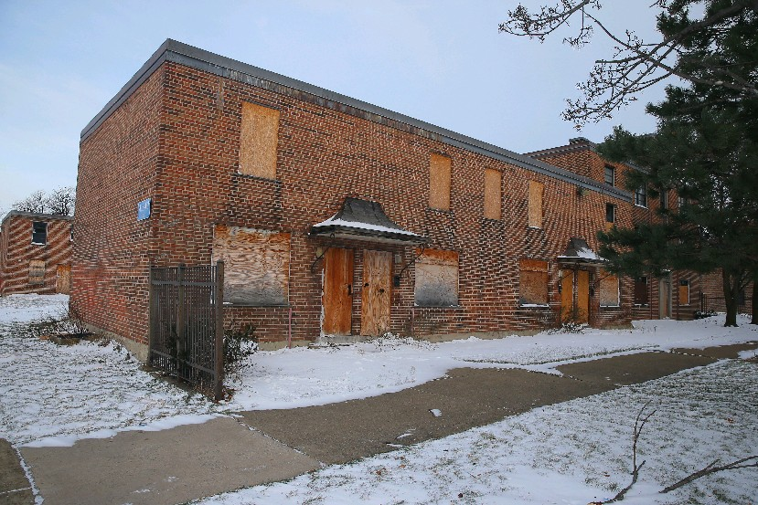Buffalo public housing officials and tenant leaders disagree over whether frequent travel to conferences helps them remedy conditions like these boarded-up buildings at Commodore Perry. (John Hickey/Buffalo News)